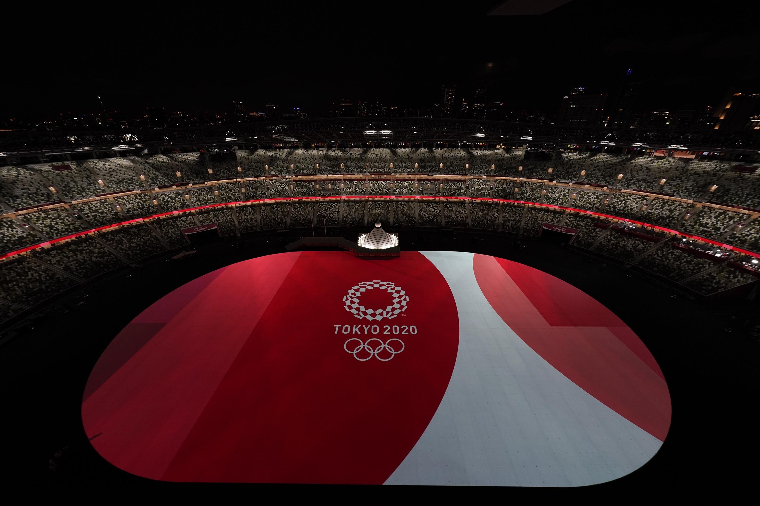 The floor of Olympic Stadium is lit before the start of the opening ceremony July 23, in Tokyo.