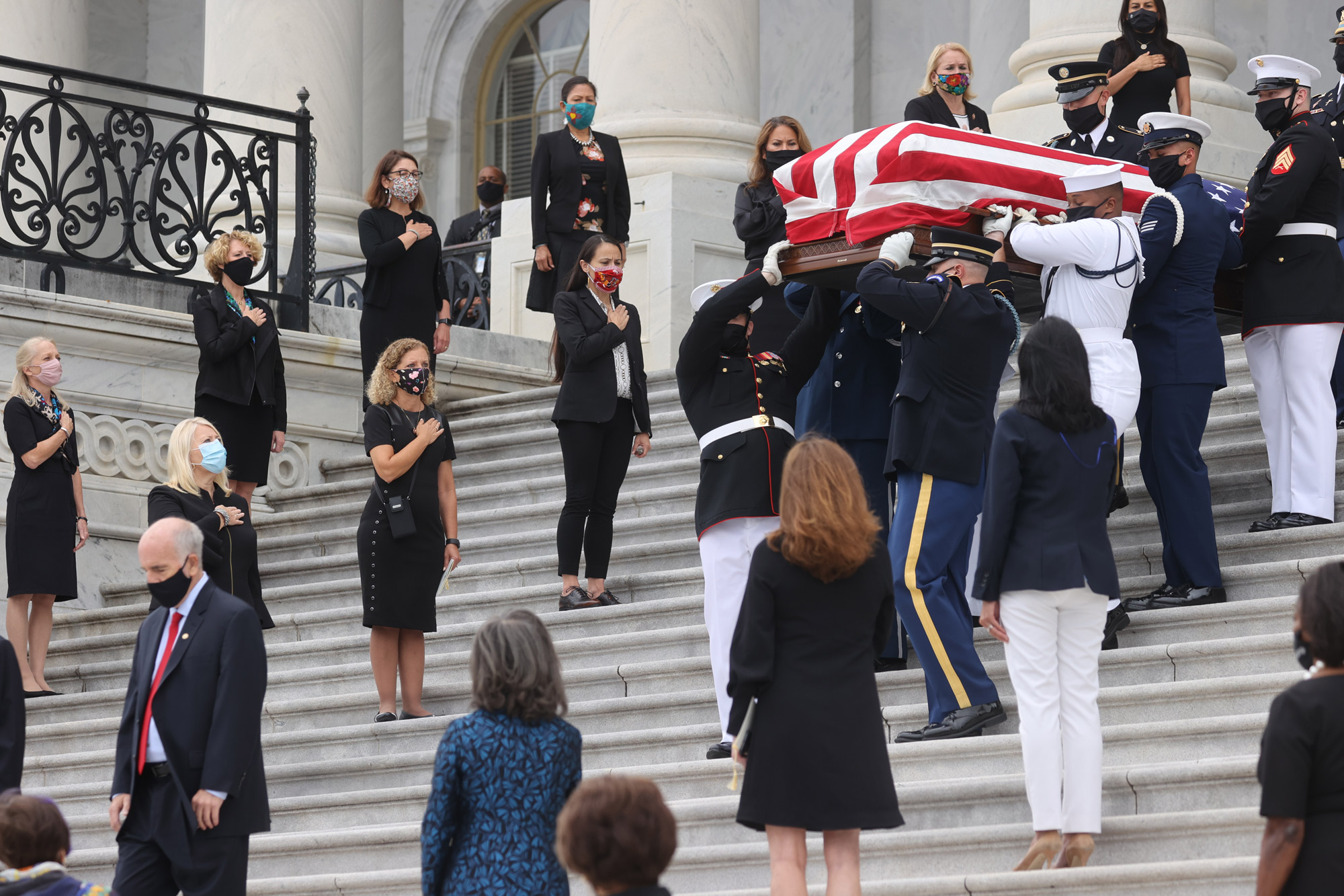 The casket of the late Supreme Court Associate Justice Ruth Bader Ginsburg is carried following ceremonies honoring Ginsburg at the U.S. Capitol on September 25 in Washington, DC.