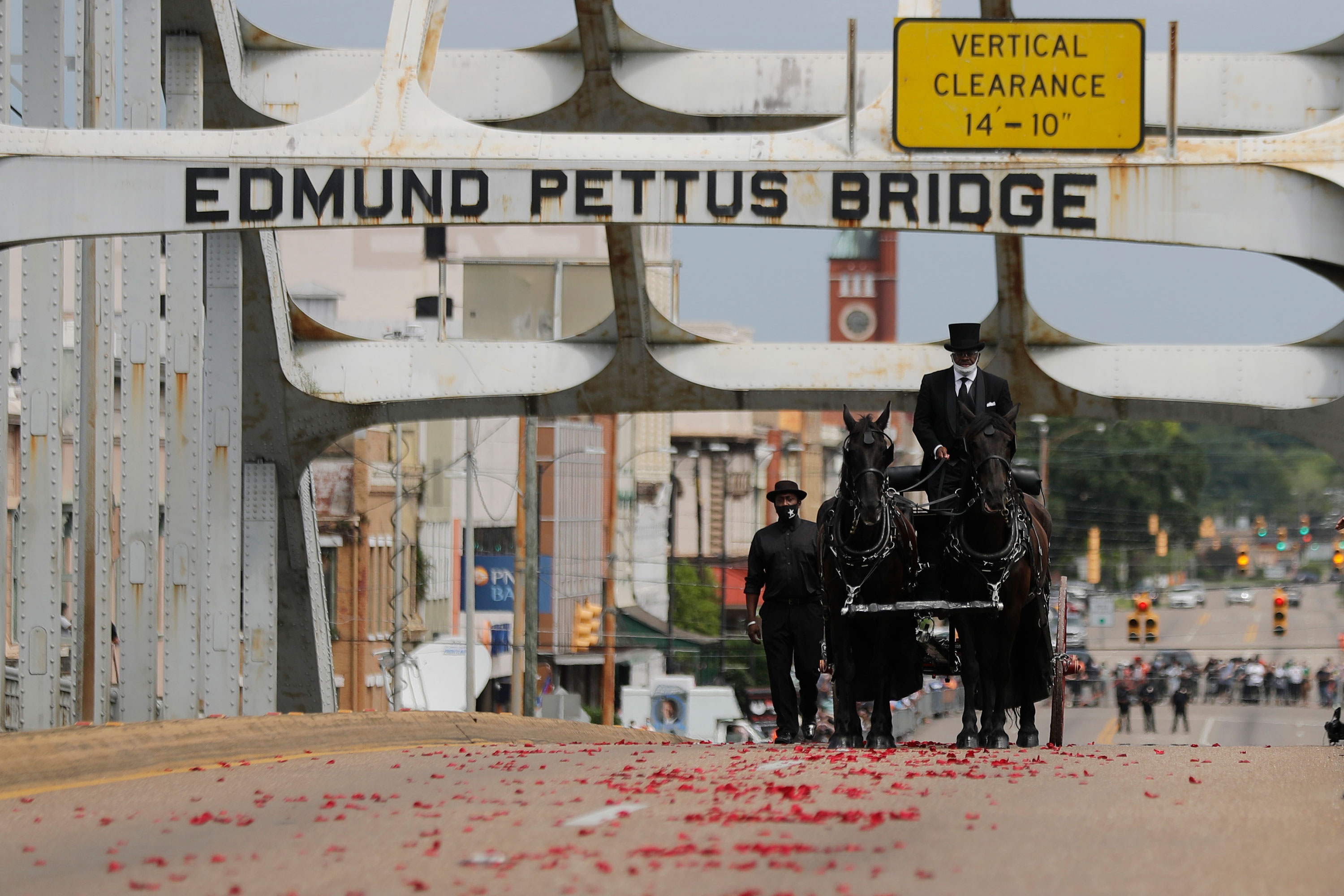 The casket of Rep. John Lewis is carried by horse-drawn carriage over the Edmund Pettus Bridge in Selma, Alabama, on July 26.