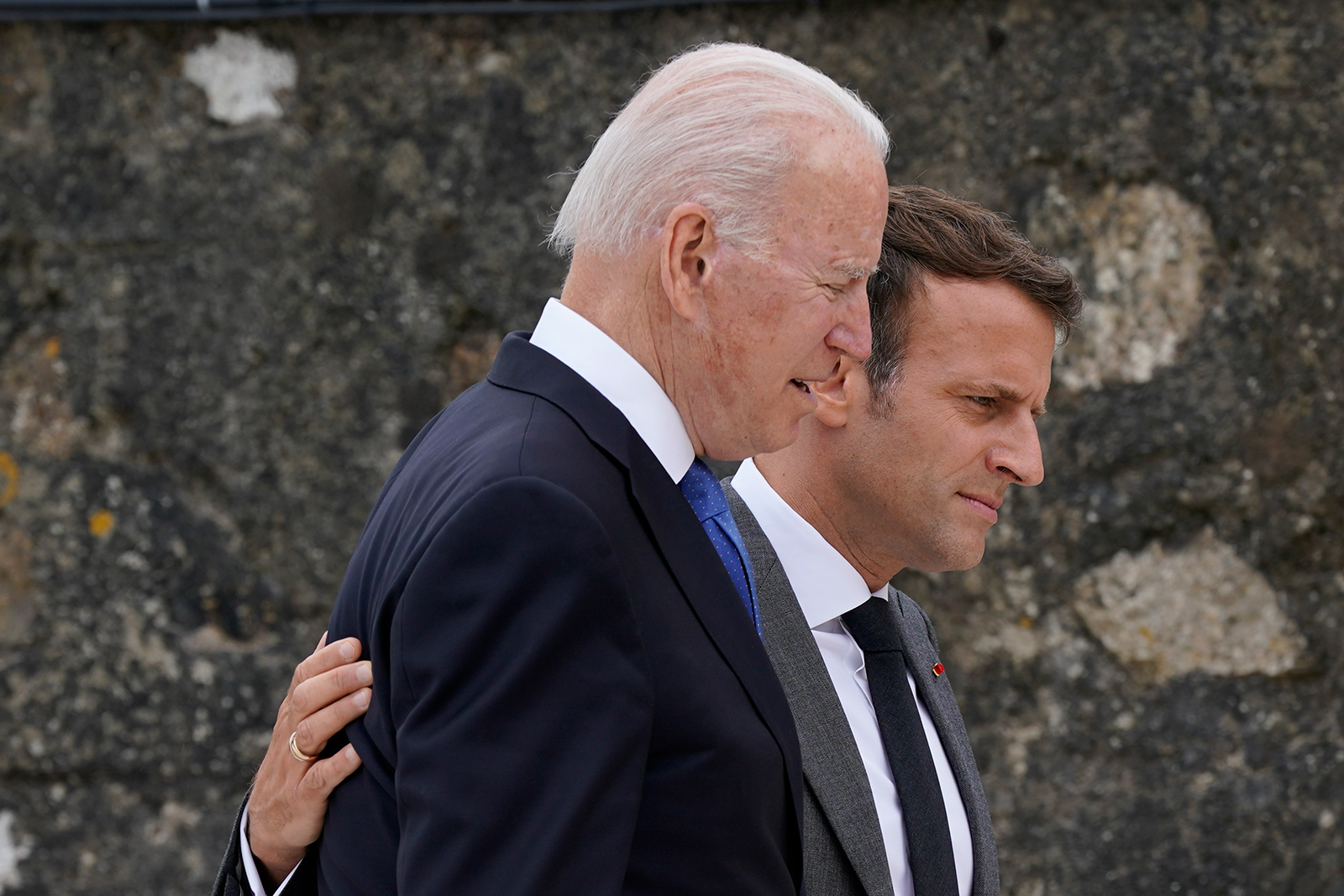 President Joe Biden speaks with French President Emmanuel Macron after posing for the G-7 family photo with guests at the G-7 summit on Friday.