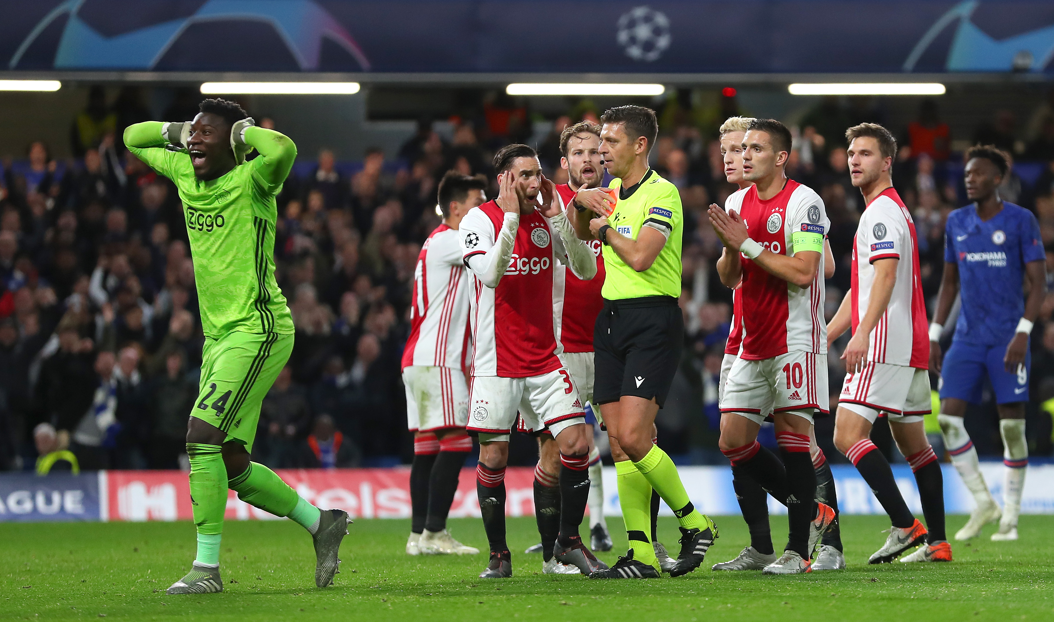 Andre Onana and Dusan Tadic of Ajax react after two red cards are given against their side.