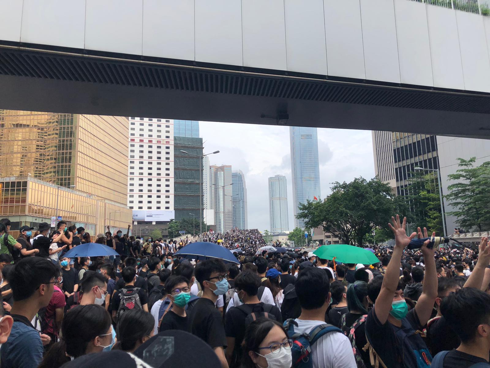 Protesters take the roads outside the Hong Kong Legislative Council.