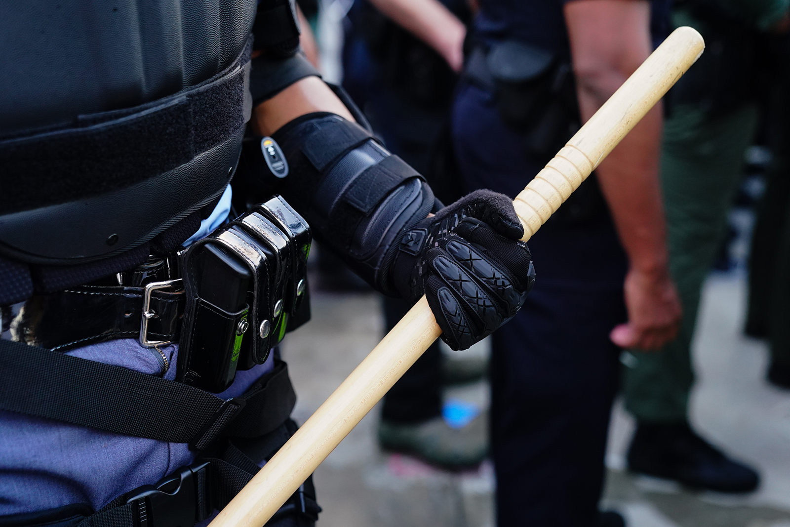 An Atlanta police officer holds a baton during a protest over th death of George Floyd on May 29, in Atlanta.