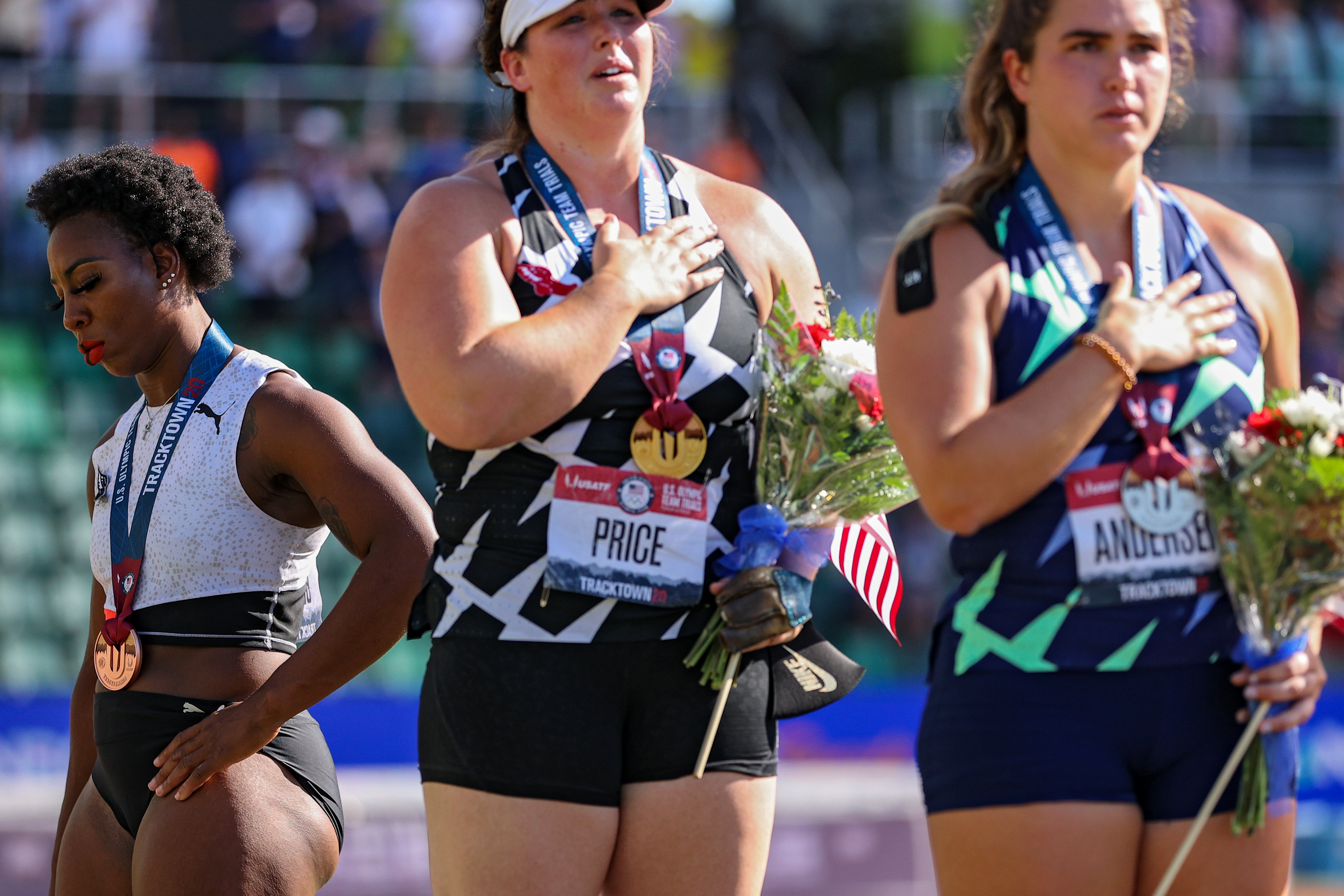 Gwen Berry turns away from U.S. flag during the national anthem.