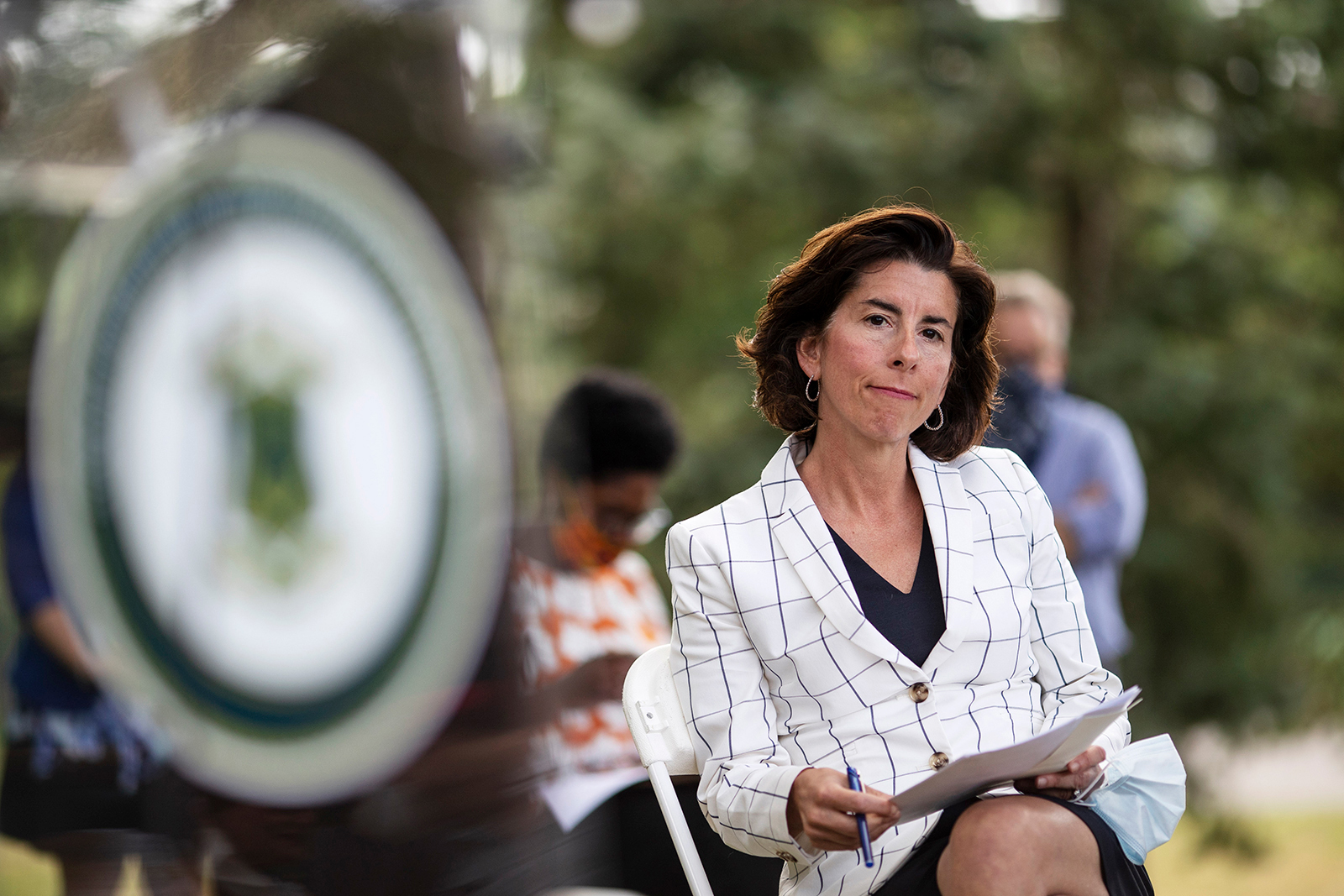 Rhode Island Gov. Gina Raimondo sits during a news conference Monday, June 22, in Providence, Rhode Island.