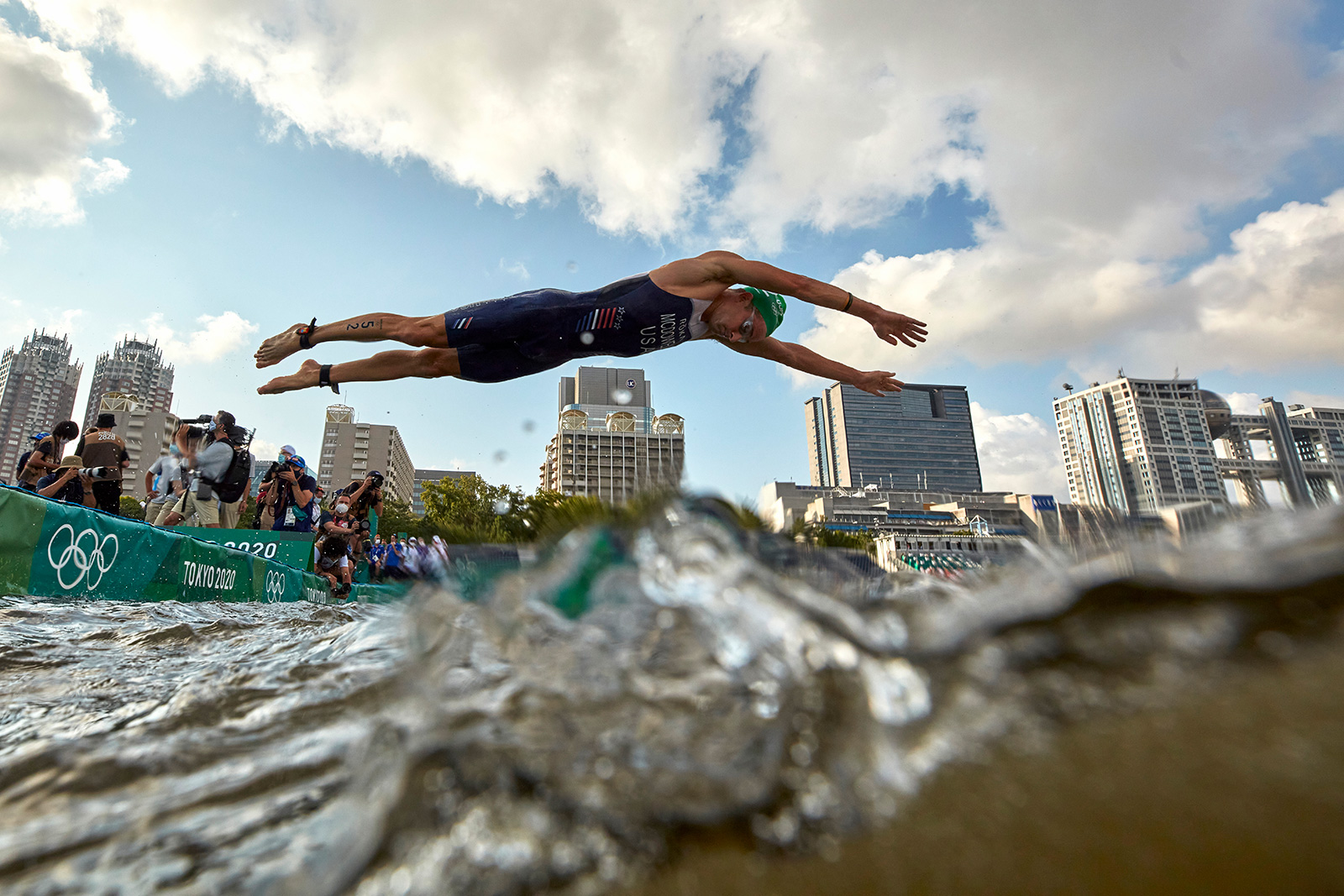 America's Kevin McDowell dives into the water to start the individual triathlon on July 26.