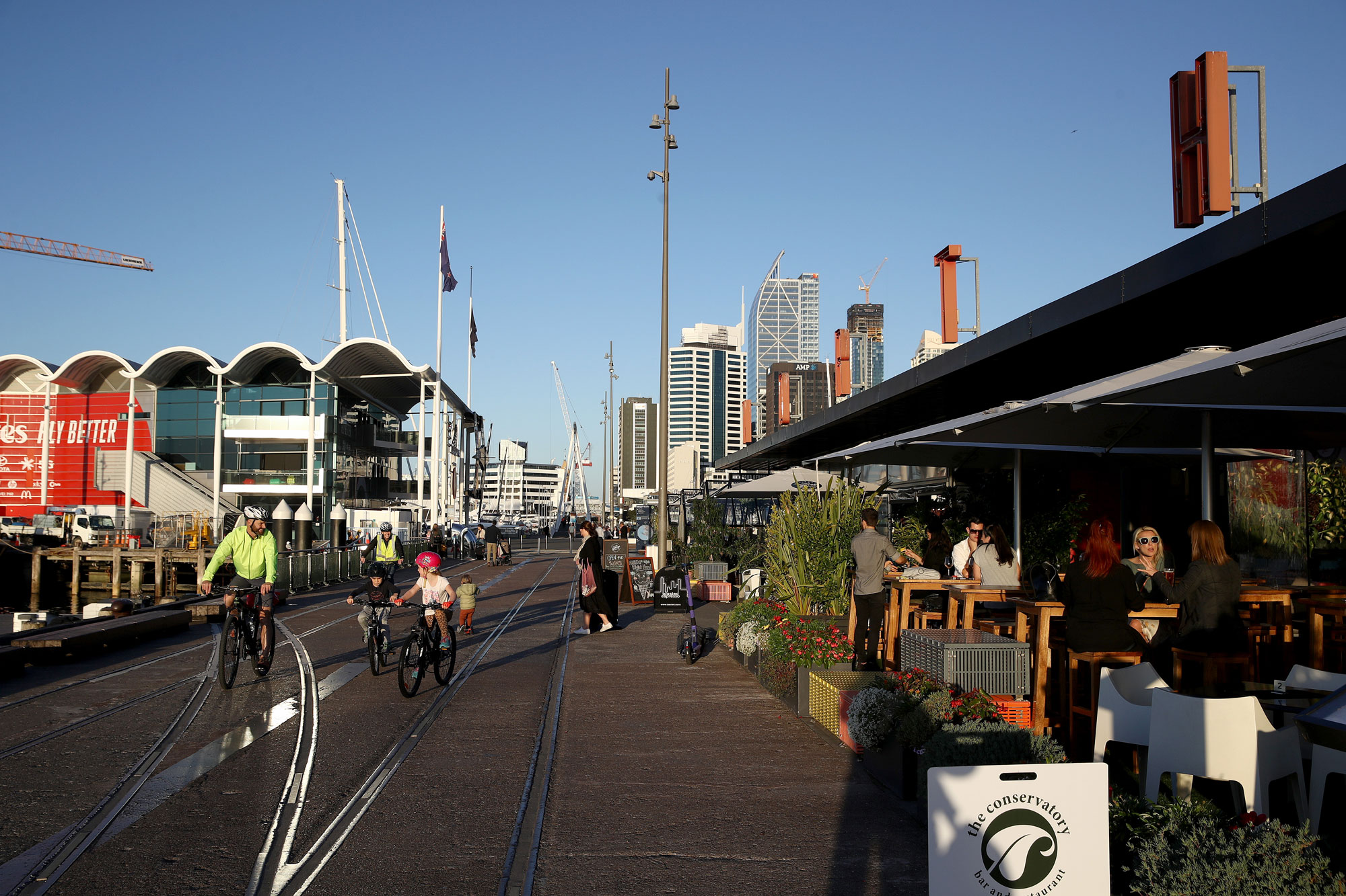 People enjoy socializing with a drink outside at the bars in Auckland's Wynard Quarter on May 21 in Auckland, New Zealand.