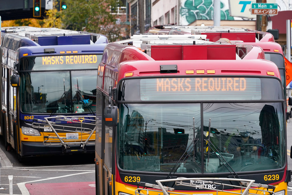 Metro buses in Seattle post signs saying masks are required on November 12.