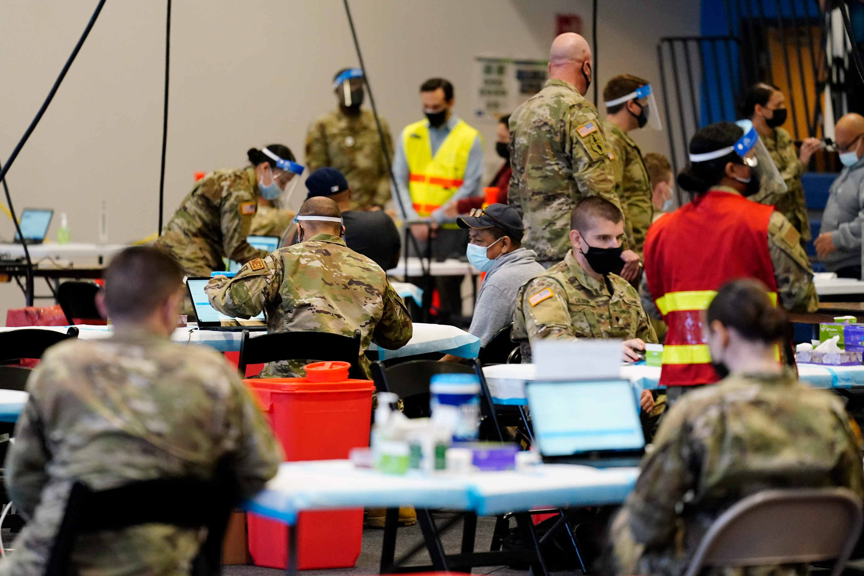 Members of the military inoculate people with the Johnson & Johnson COVID-19 vaccine at the Esperanza Community Vaccination Center in Philadelphia on April 9.
