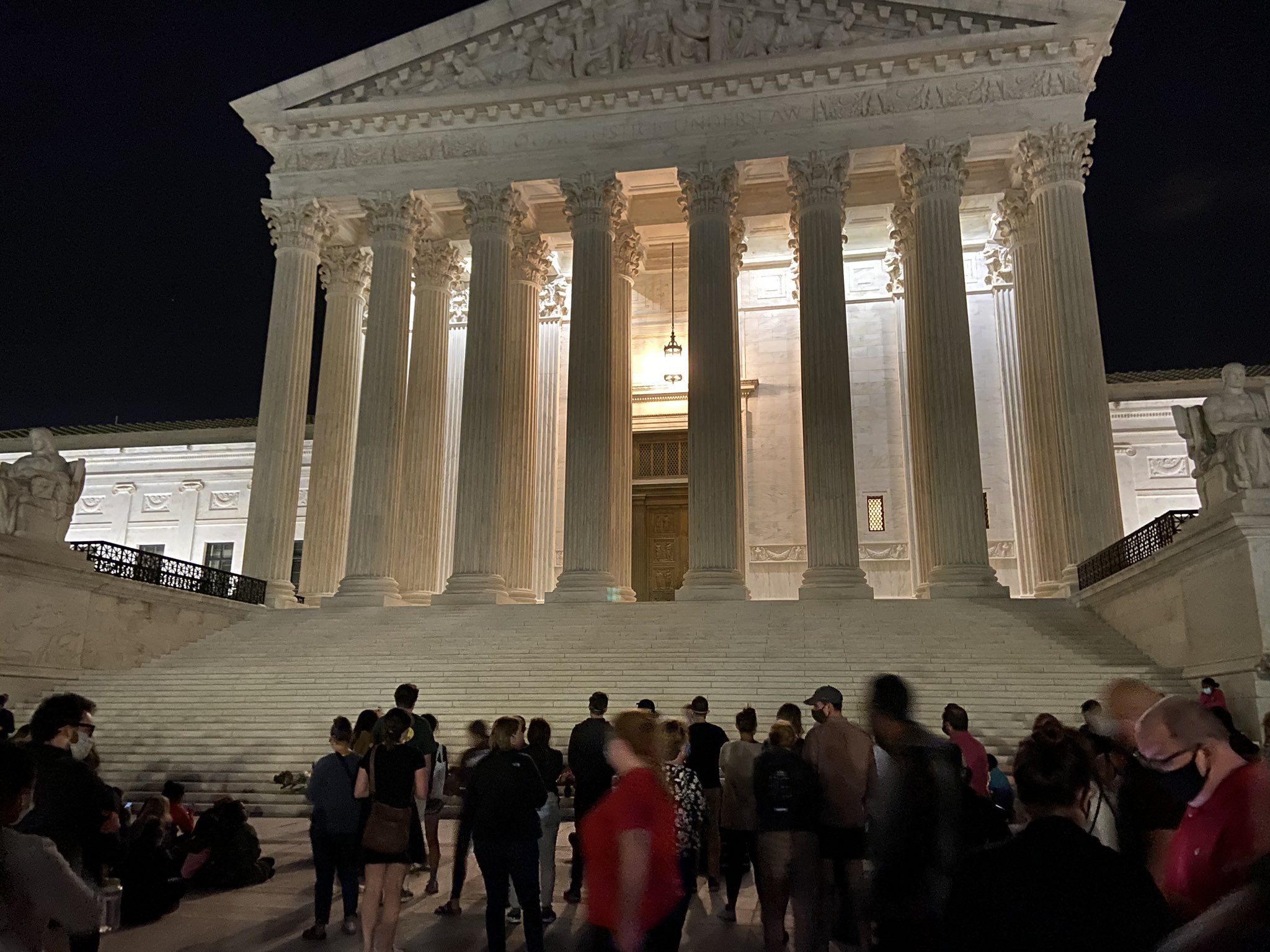 Mourners are holding a candlelight vigil outside of the Supreme Court