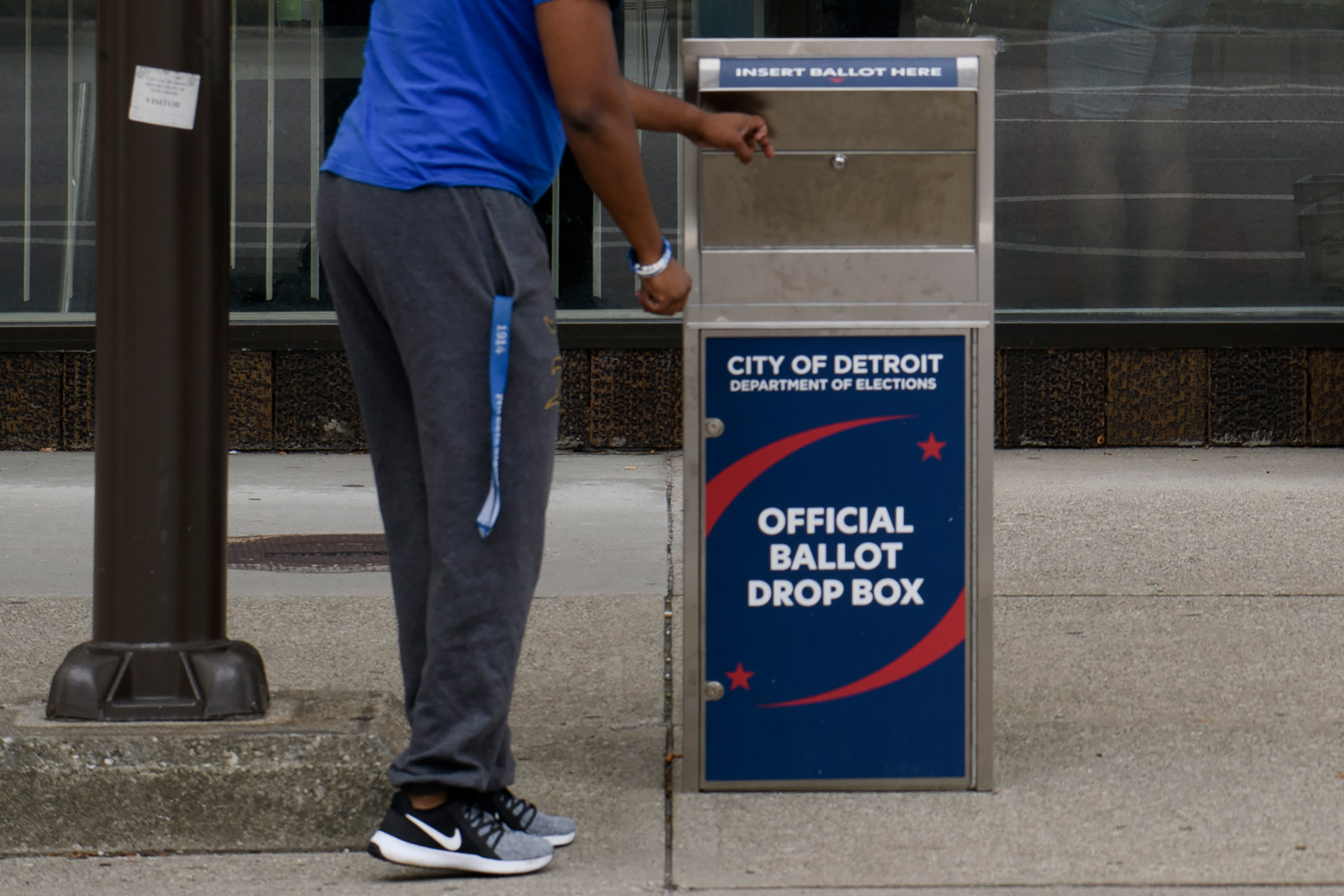 A man drops off his absentee ballot outside of the City of Detroit Department of Elections during the Michigan Primary Election on August 4,  in Detroit, Michigan.