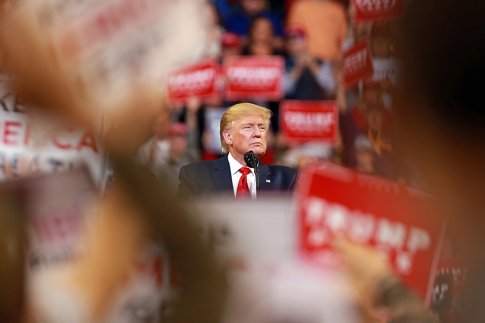 In this November 14, 2019 file photo, President Donald Trump pauses speaking at a rally in Bossier City, Louisiana.