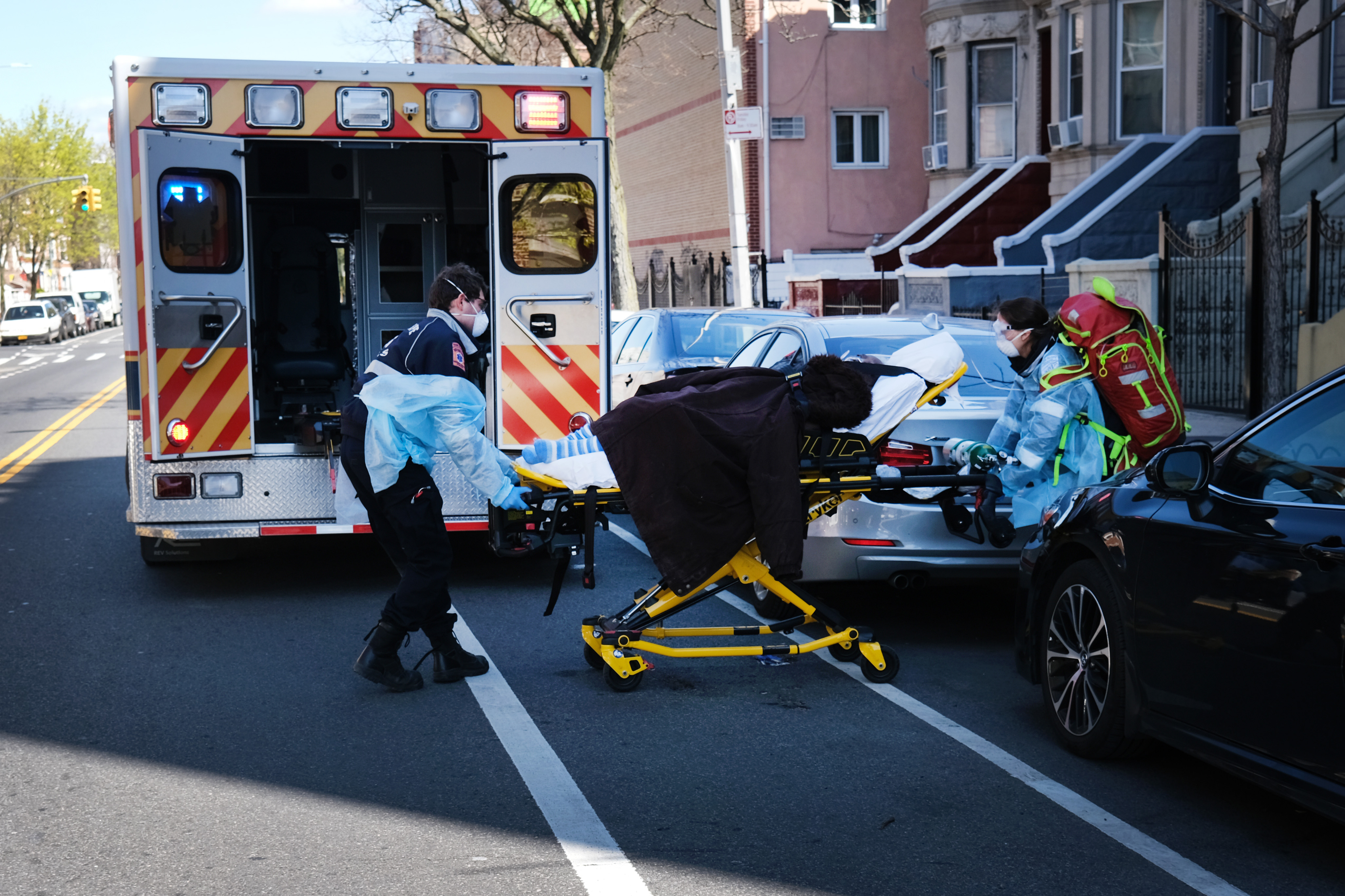 Health workers wheel a patient to an ambulance in Brooklyn, New York, on April 11.