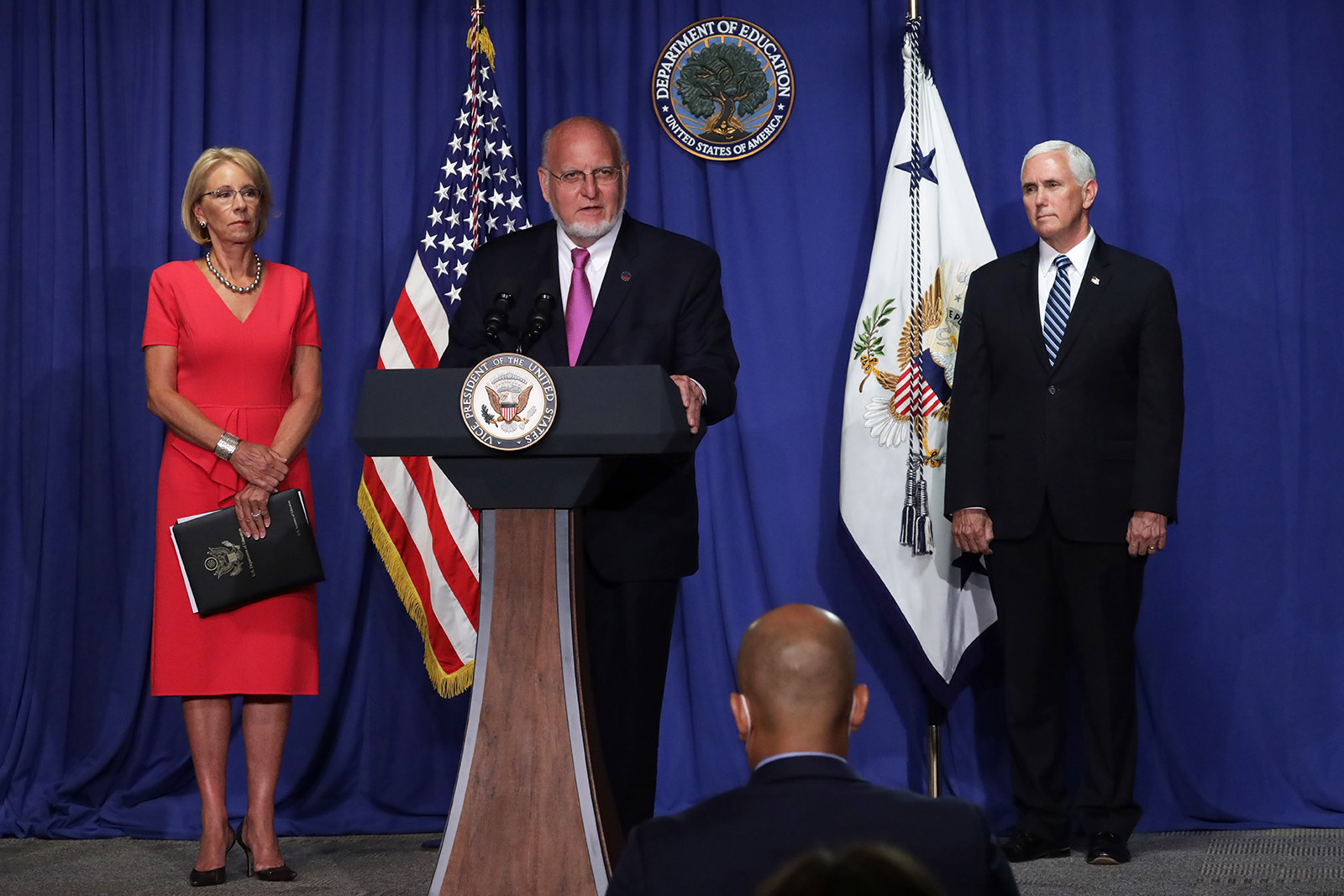 CDC Director Robert Redfield speaks as US Education Secretary Betsy DeVos and Vice President Mike Pence listen during a briefing at the US Department of Education on July 8.