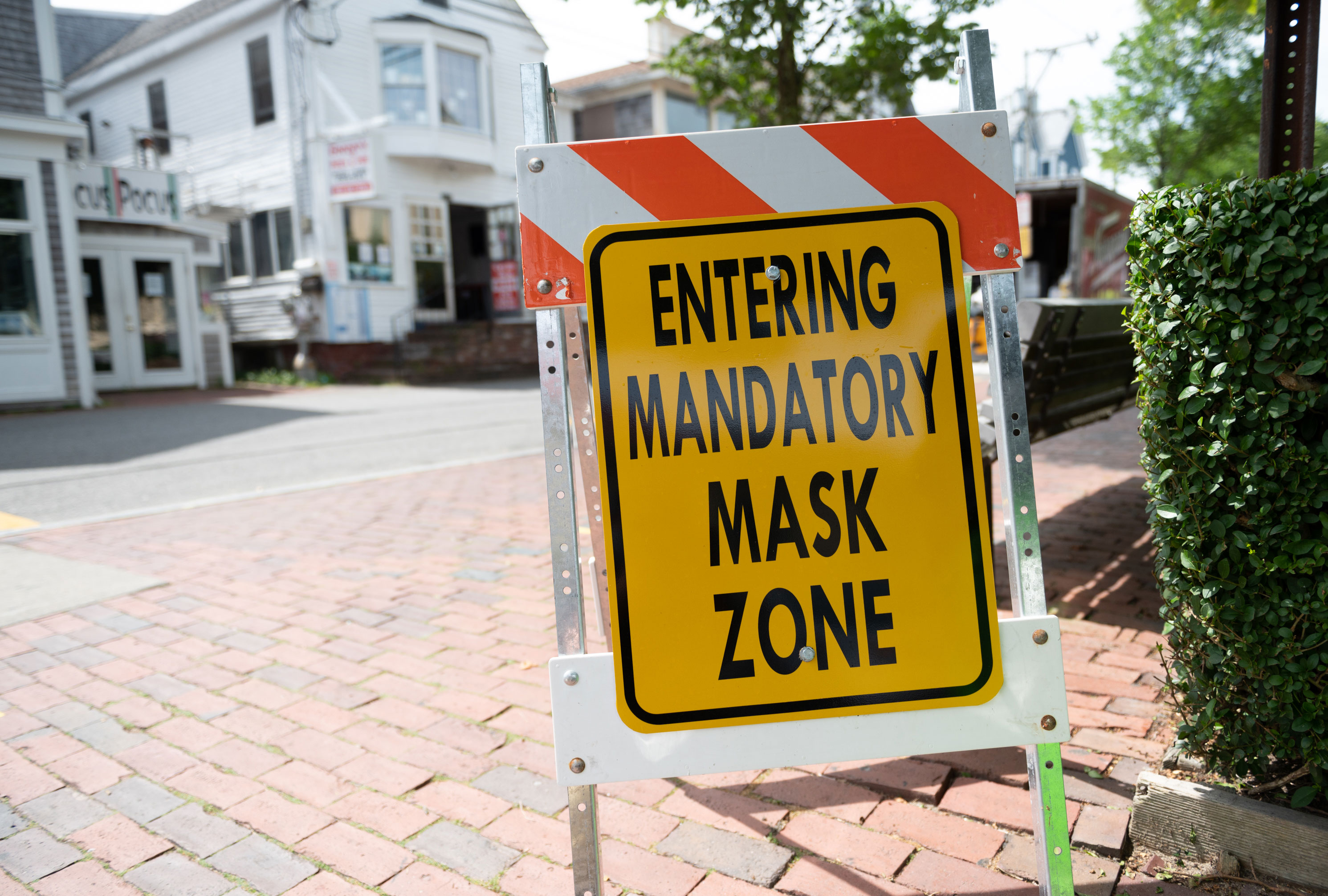 The Provincetown, Massachusetts, plate informs people of a mandatory mask area on July 10th.