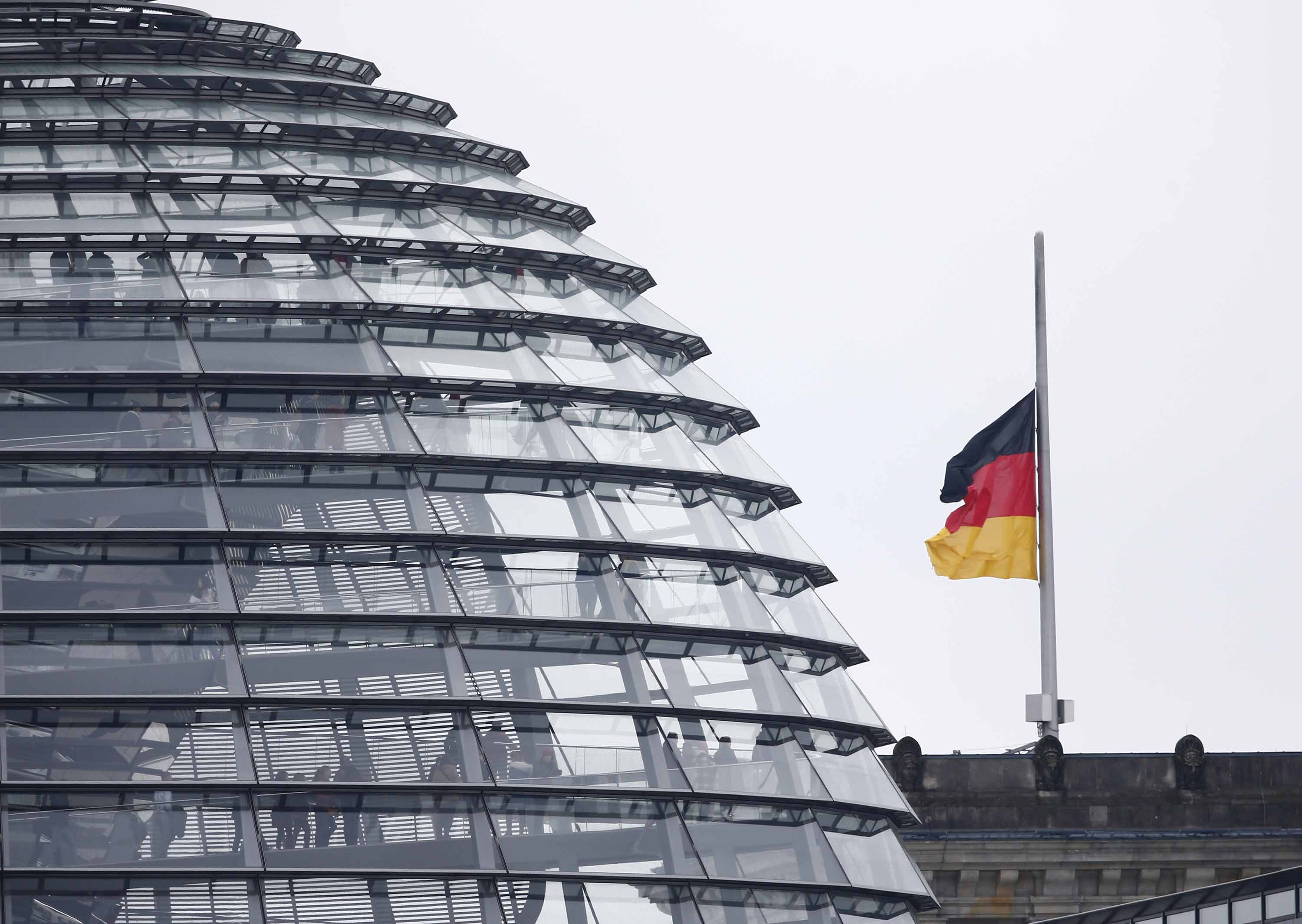 Germany's flag flies at half mast atop the Bundestag in Berlin on Thursday.