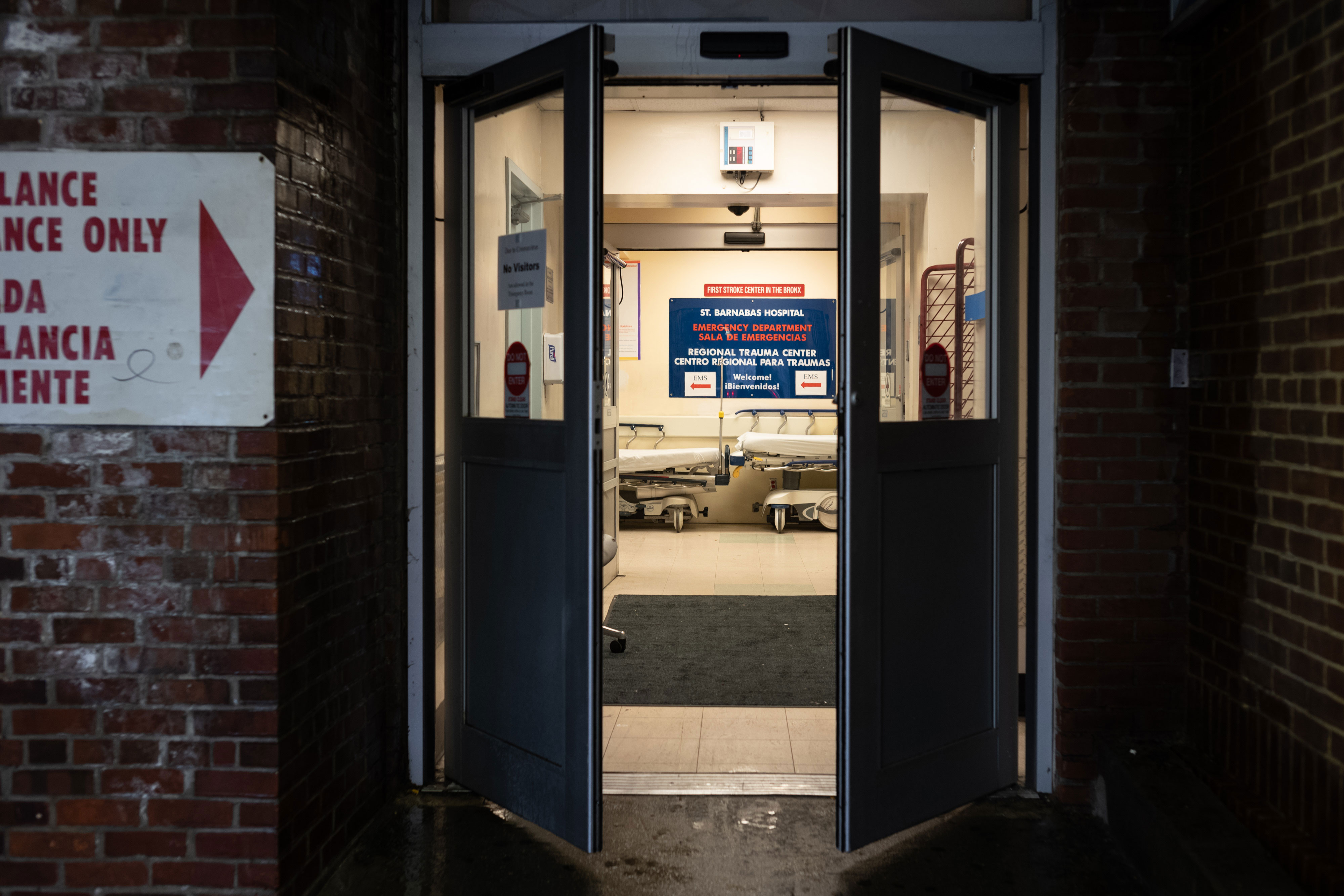 Doors open into the emergency department at St. Barnabas Hospital in New York, on March 23.