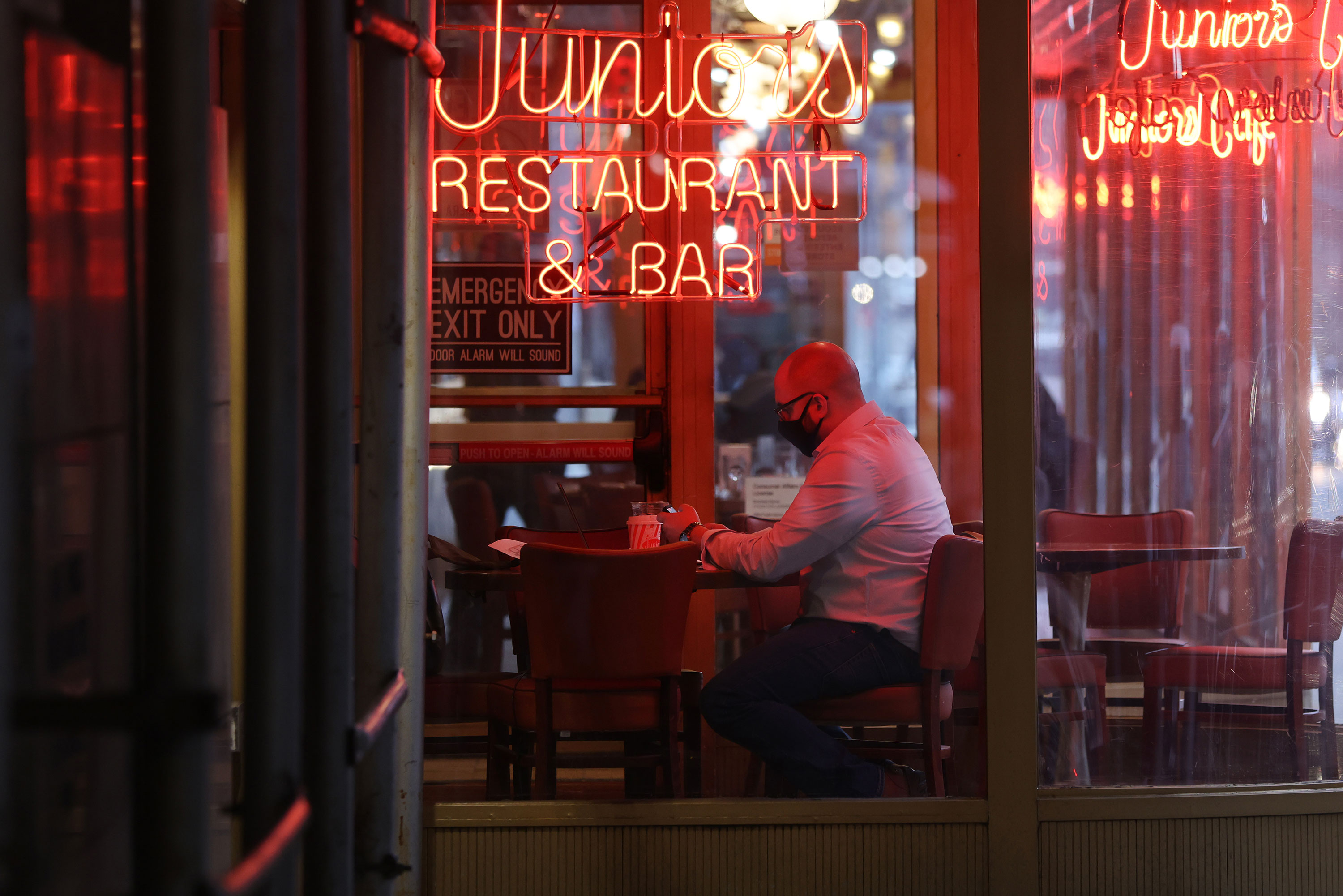 A man sits in a restaurant in Brooklyn on December 1 in New York City.