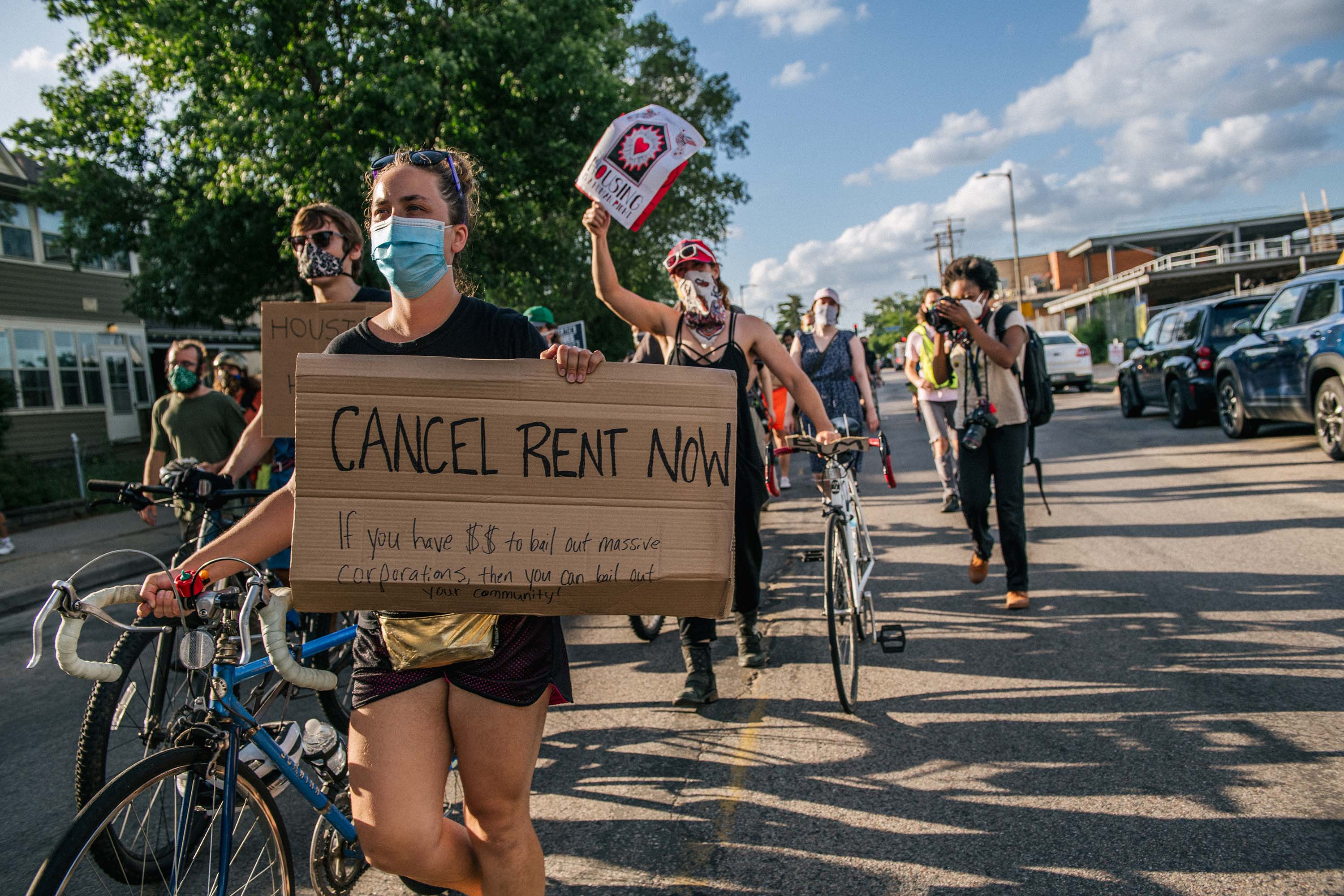 Demonstrators march in the street during the Cancel Rent and Mortgages rally in Minneapolis, Minnesota on June 30.