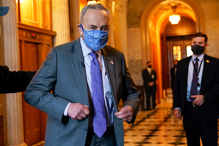 Schumer heads to an interview on Capitol Hill in Washington, DC, on Monday, January 25,