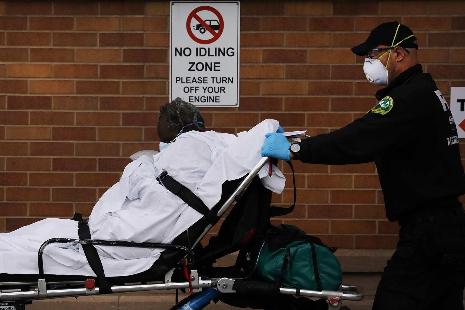 Medical workers transport a patient outside of a special coronavirus intake area at Maimonides Medical Center on April 27, in the Brooklyn borough of New York City.