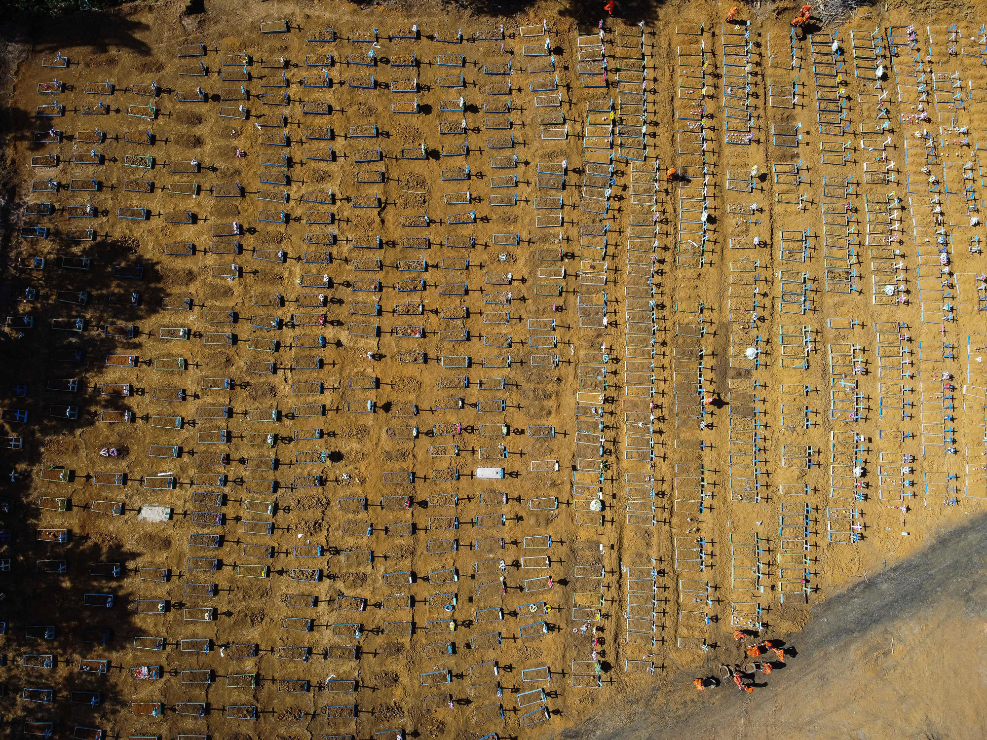 This aerial photo, taken on Tuesday, June 2, shows the Nossa Senhora Aparecida cemetery, where coronavirus victims are buried daily in Manaus, Brazil.