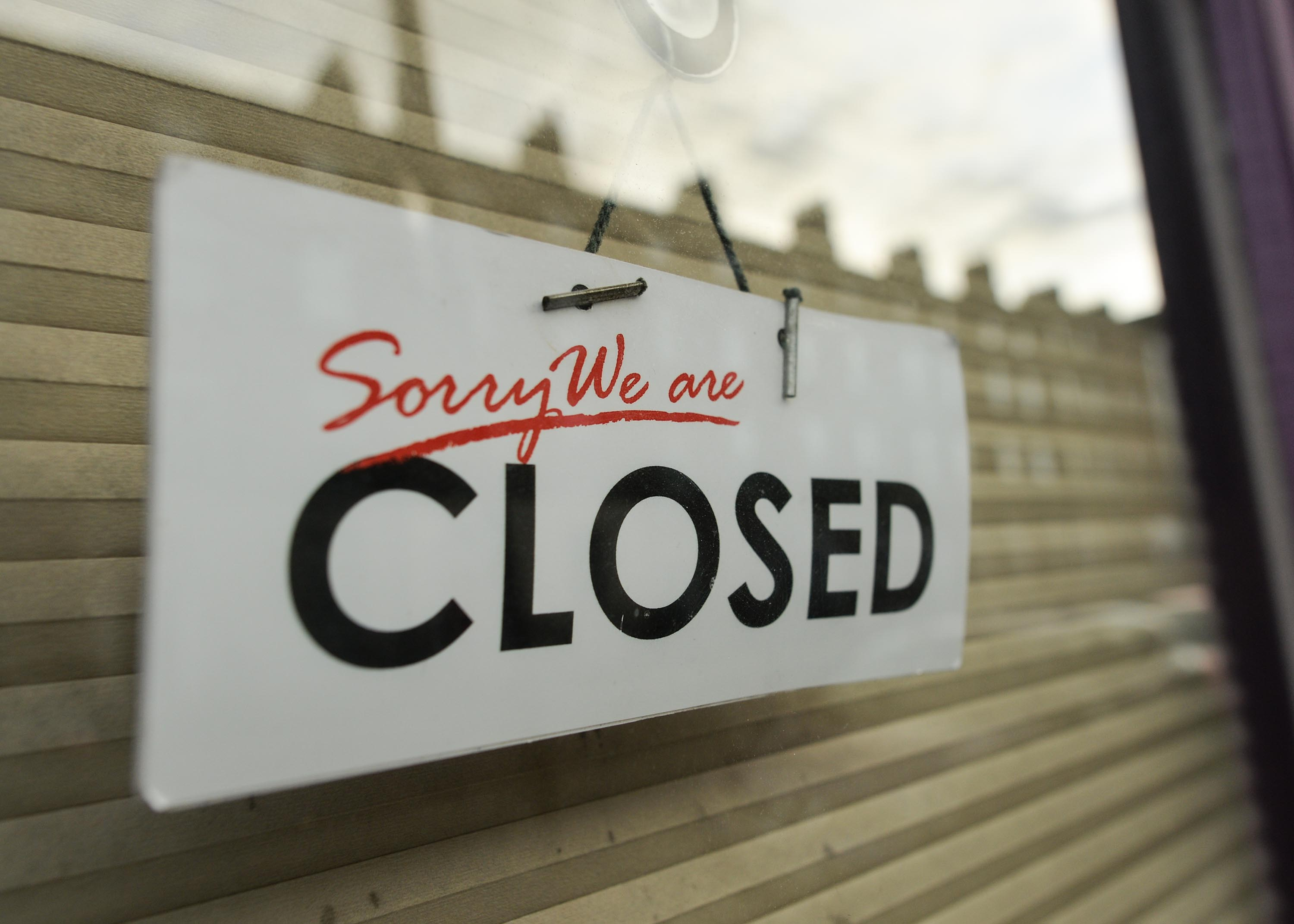 In this November 23, 2020 file photo, a closed sign is seen in a shop window in Dublin's city centre.