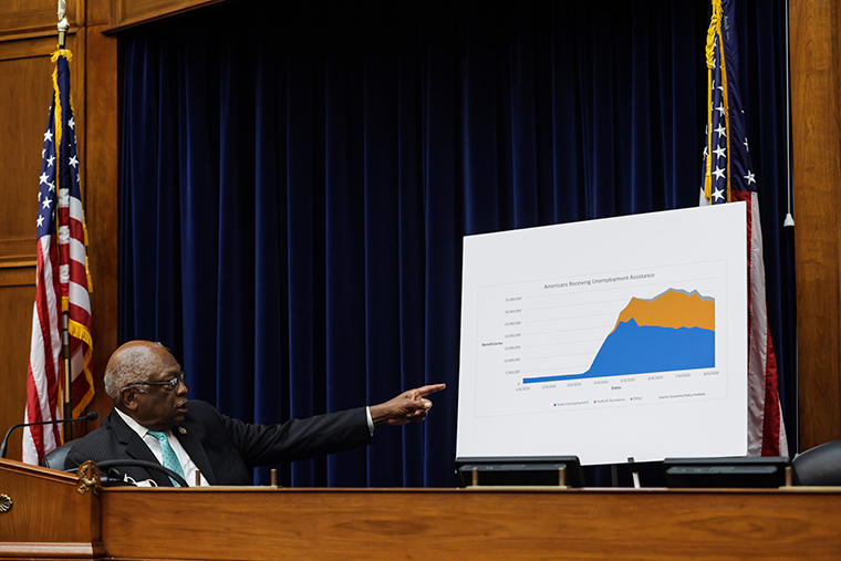 Oversight and Reform Subcommittee Chairman James E. Clyburn points to a sign displaying information on unemployment in the United States, during the House Select Subcommittee on the Coronavirus Crisis on Capitol Hill in Washington, DC, on September 1, 2020.
