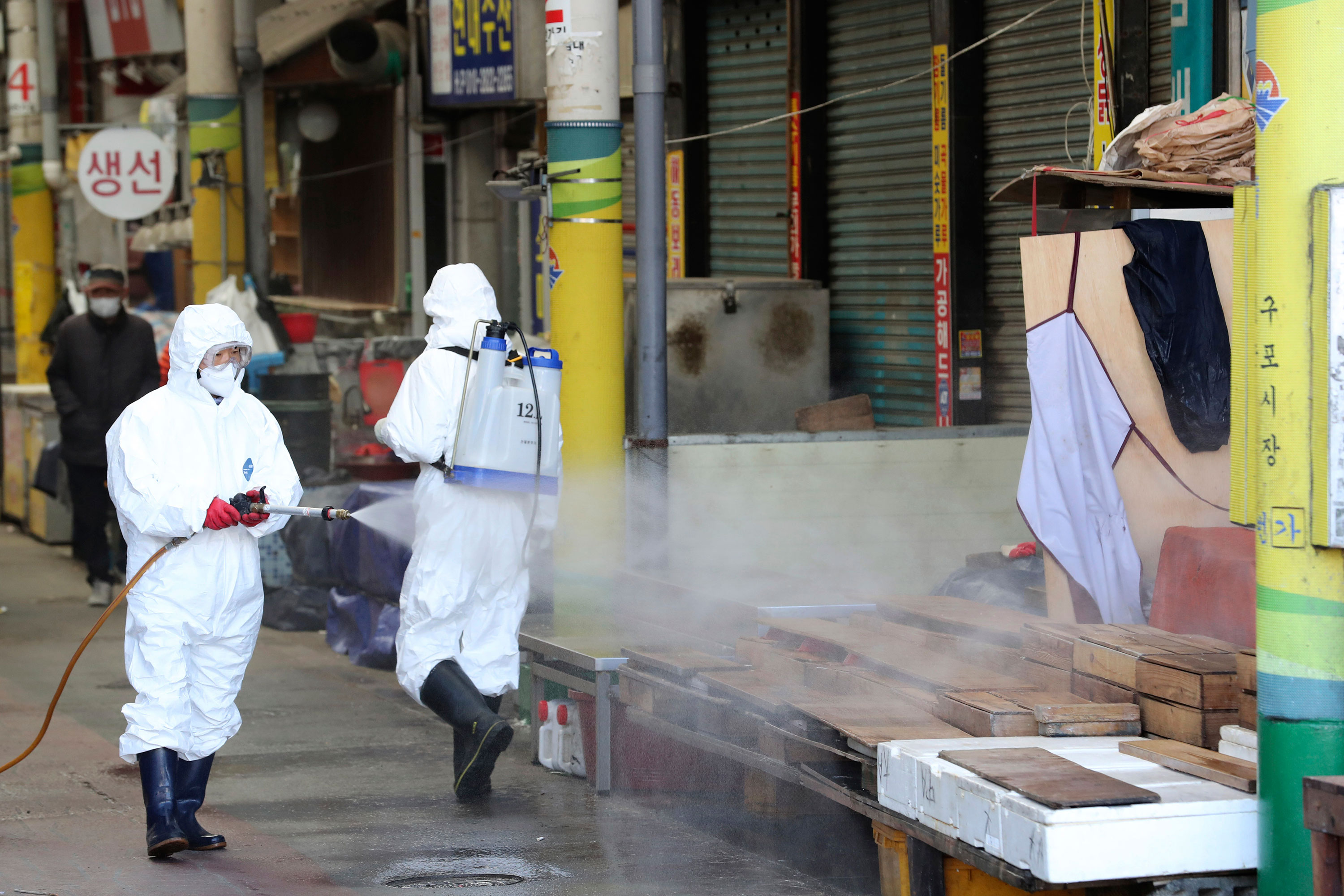 Workers spray disinfectant at a market in Busan, South Korea on Sunday.