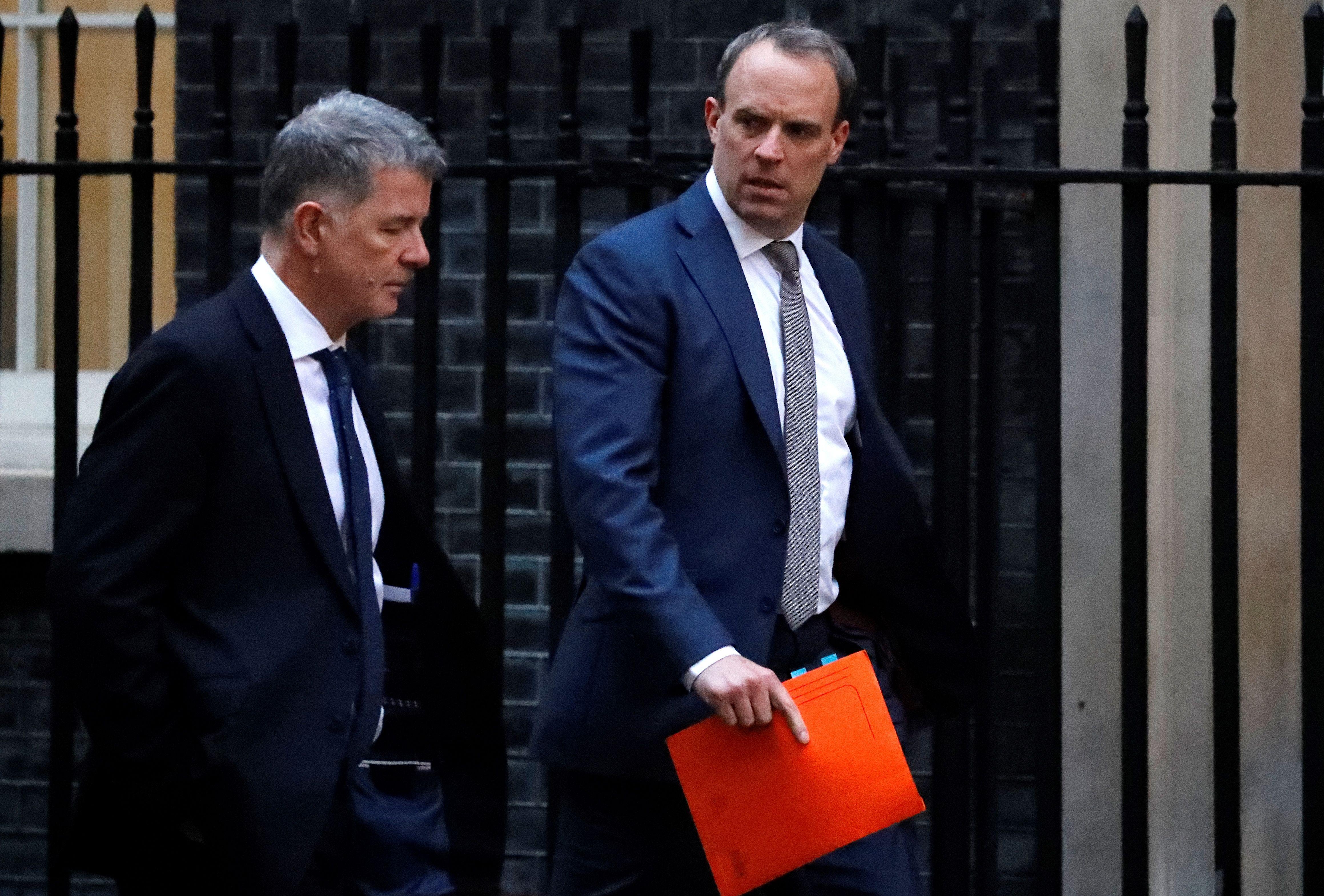 UK Foreign Secretary Dominic Raab (R) walks towards 10 Downing Street on January 6, 2020.