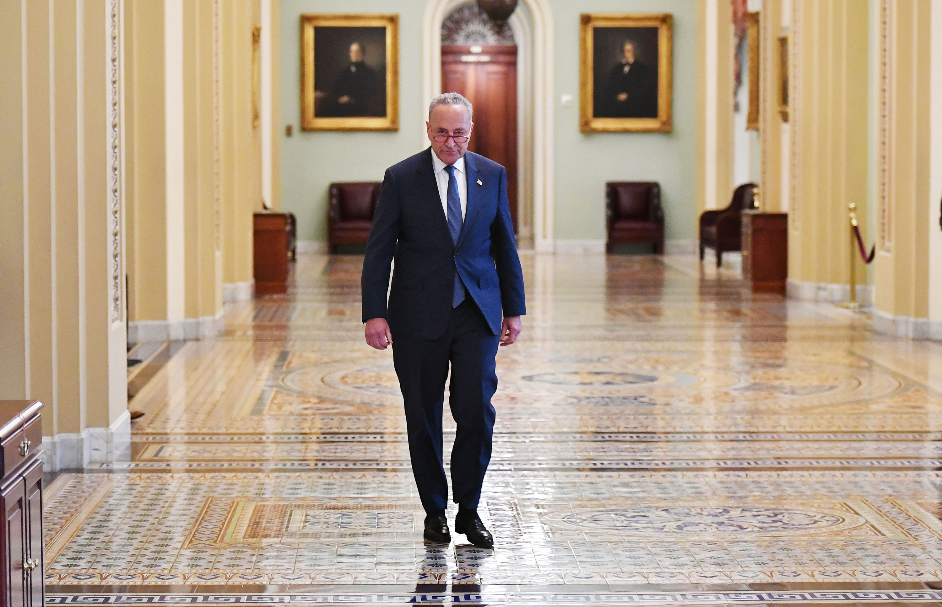 Schumer walks to his office after speaking on the Senate floor.
