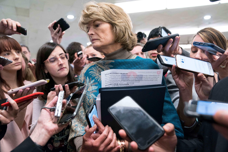 US Sen. Lisa Murkowski speaks to reporters as she walks to the Senate subway on Monday.