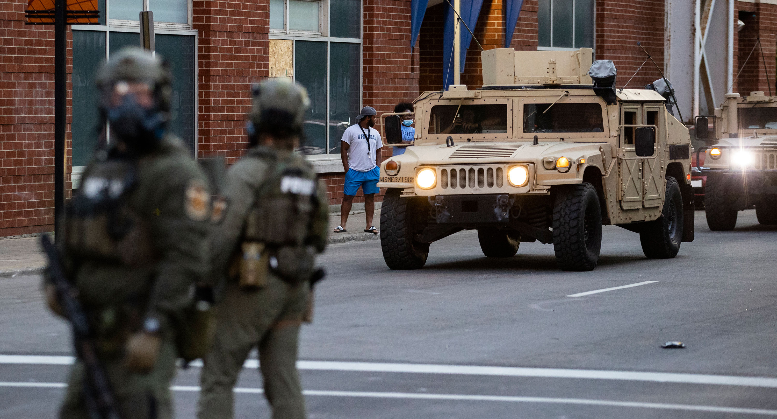 National Guard vehicles drive into downtown Louisville on May 30.