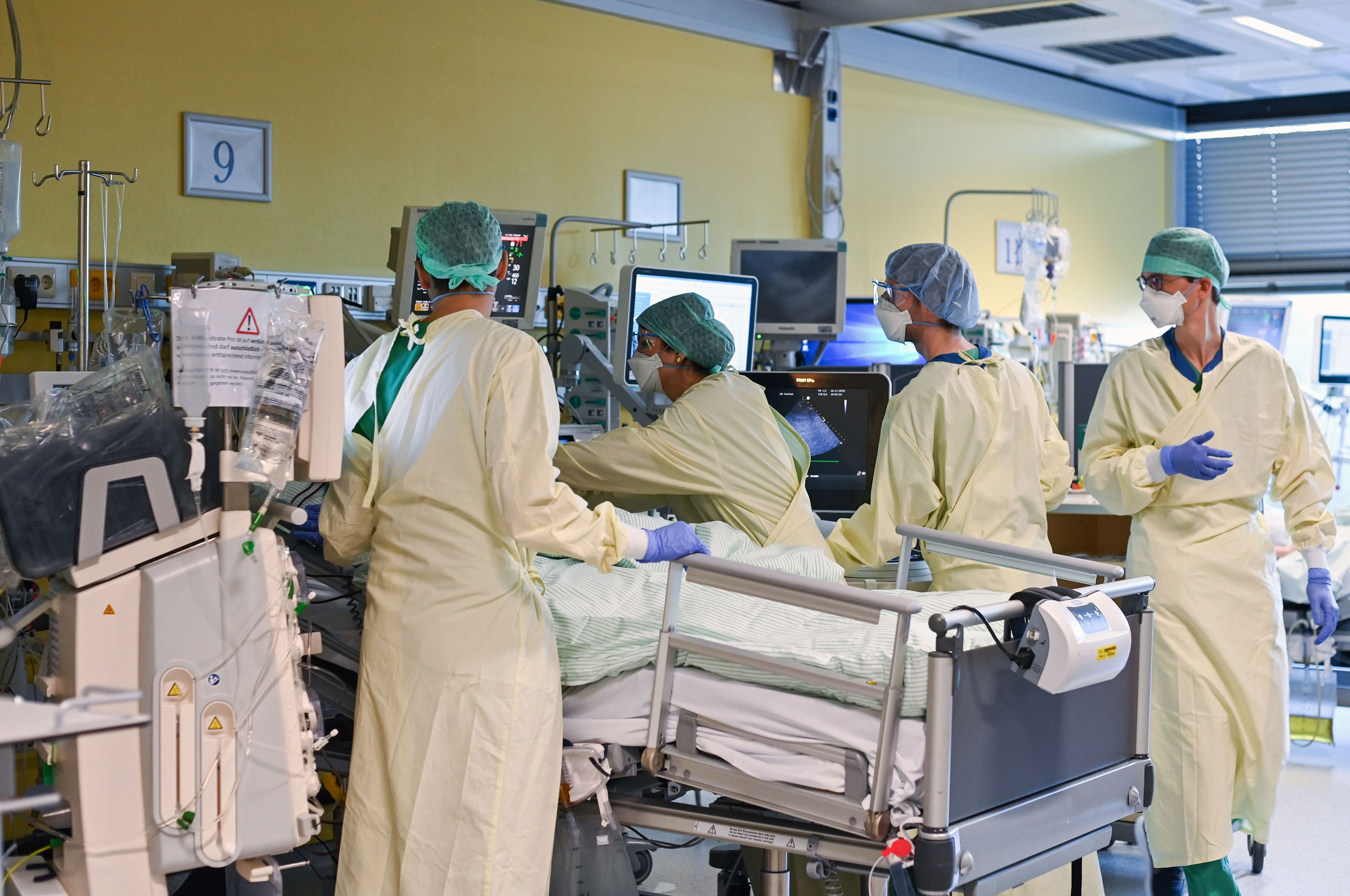 Medical personnel at a hospital in Aachen, Germany, examine a Covid-19 patient in the intensive care unit on November 10.