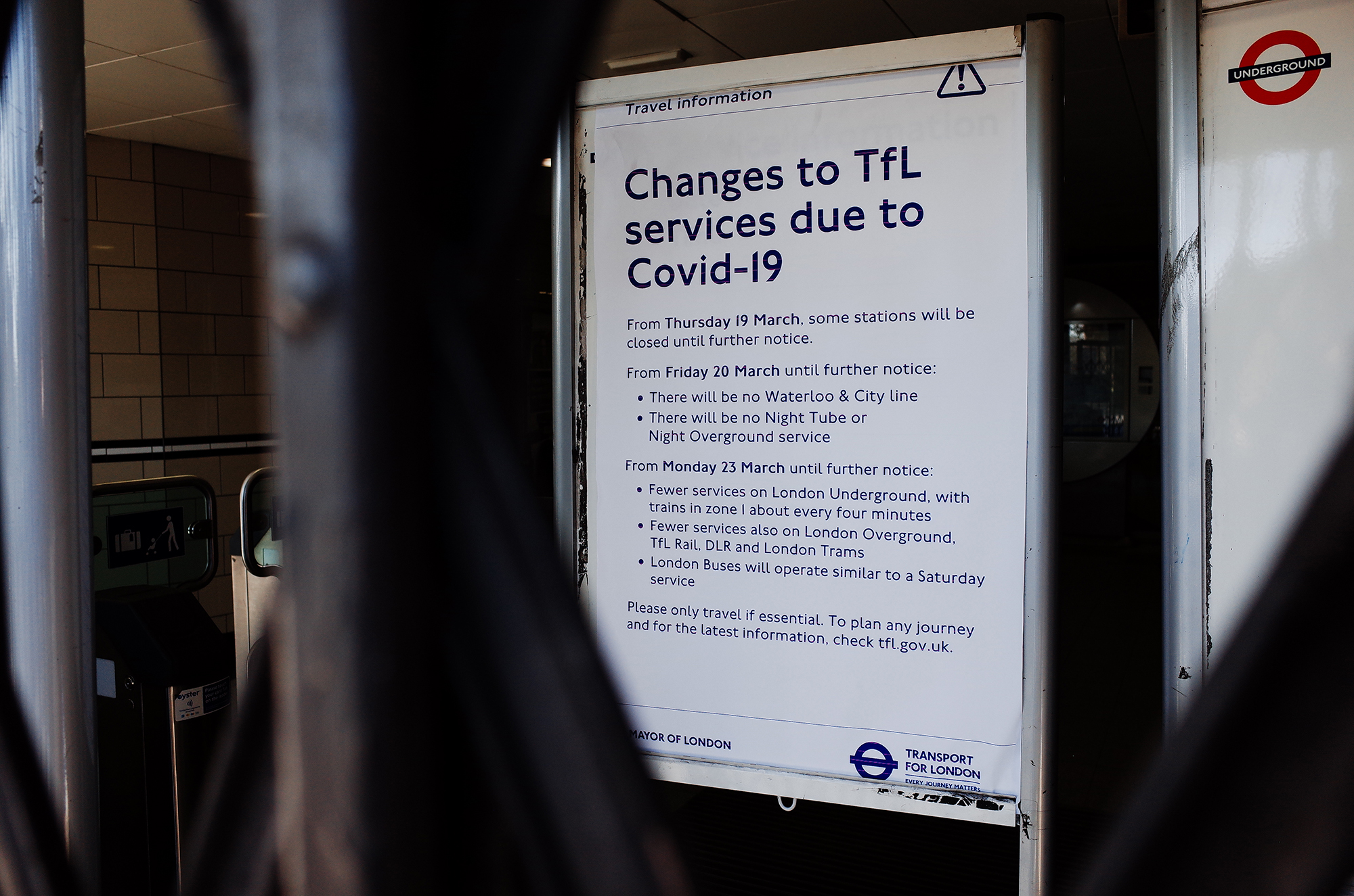 Signs informing passengers of the temporary closure of many stations on the London Underground network stand inside a shuttered Lancaster Gate station in London, England, on Tuesday, March 24.