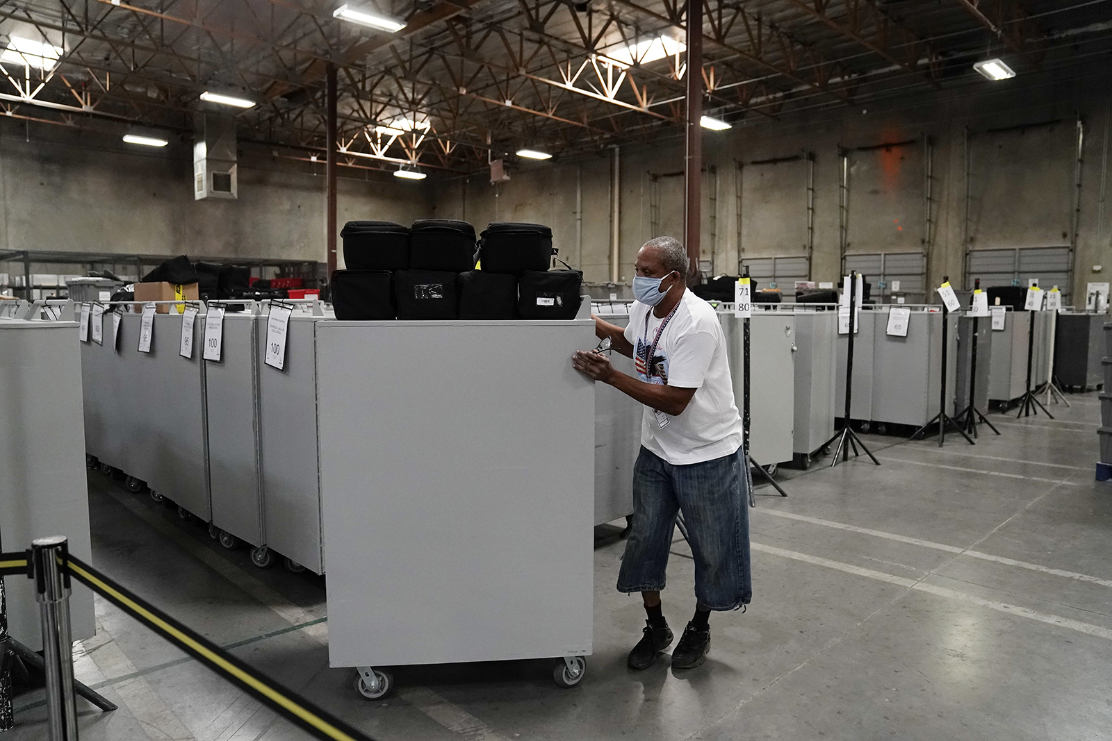 An election warehouse worker moves polling place equipment at the Clark County Election Department in North Las Vegas, Nevada on Friday.