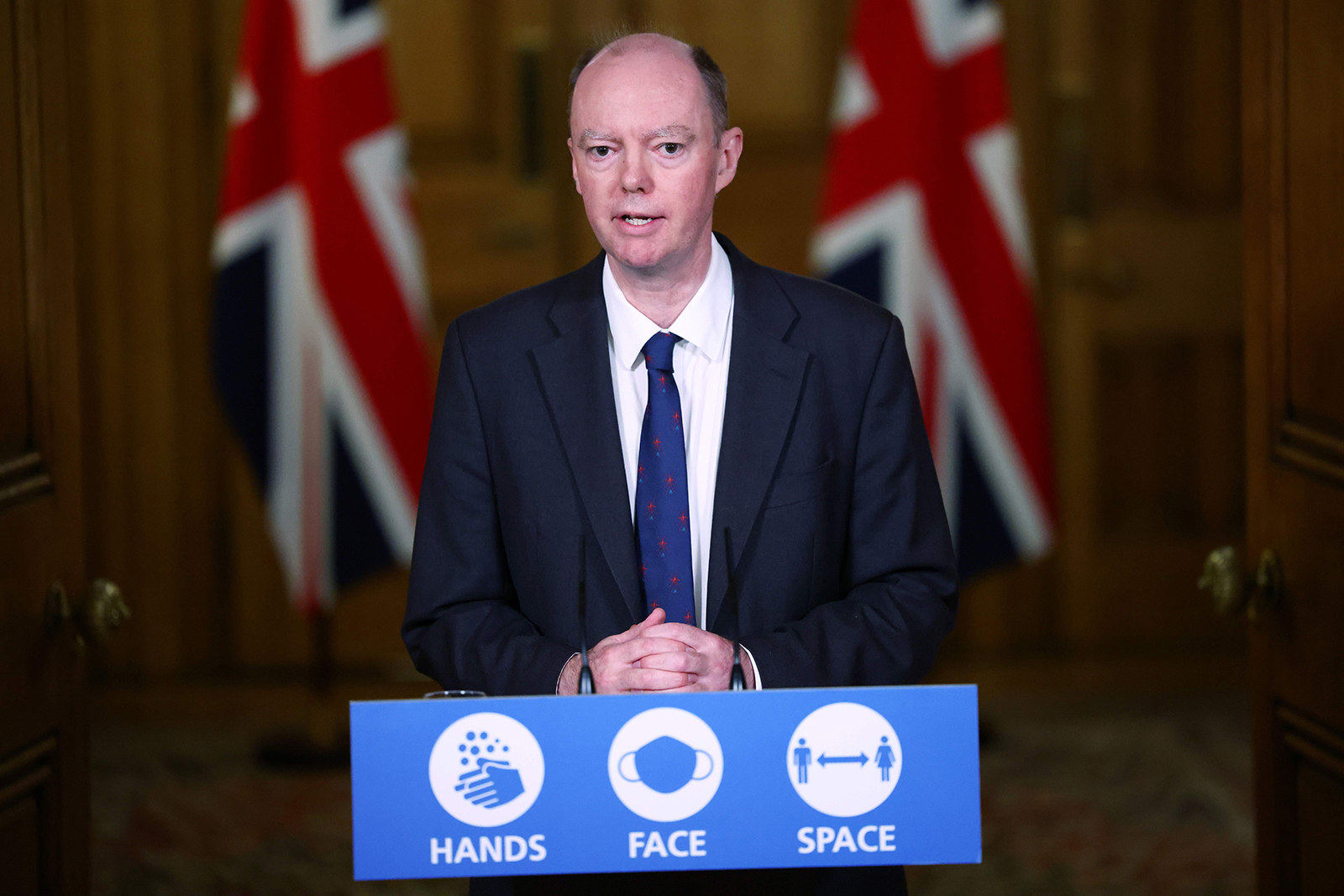 Britain's Chief Medical Officer for England Chris Whitty speaks during a virtual press conference inside 10 Downing Street in central London, on November 23.
