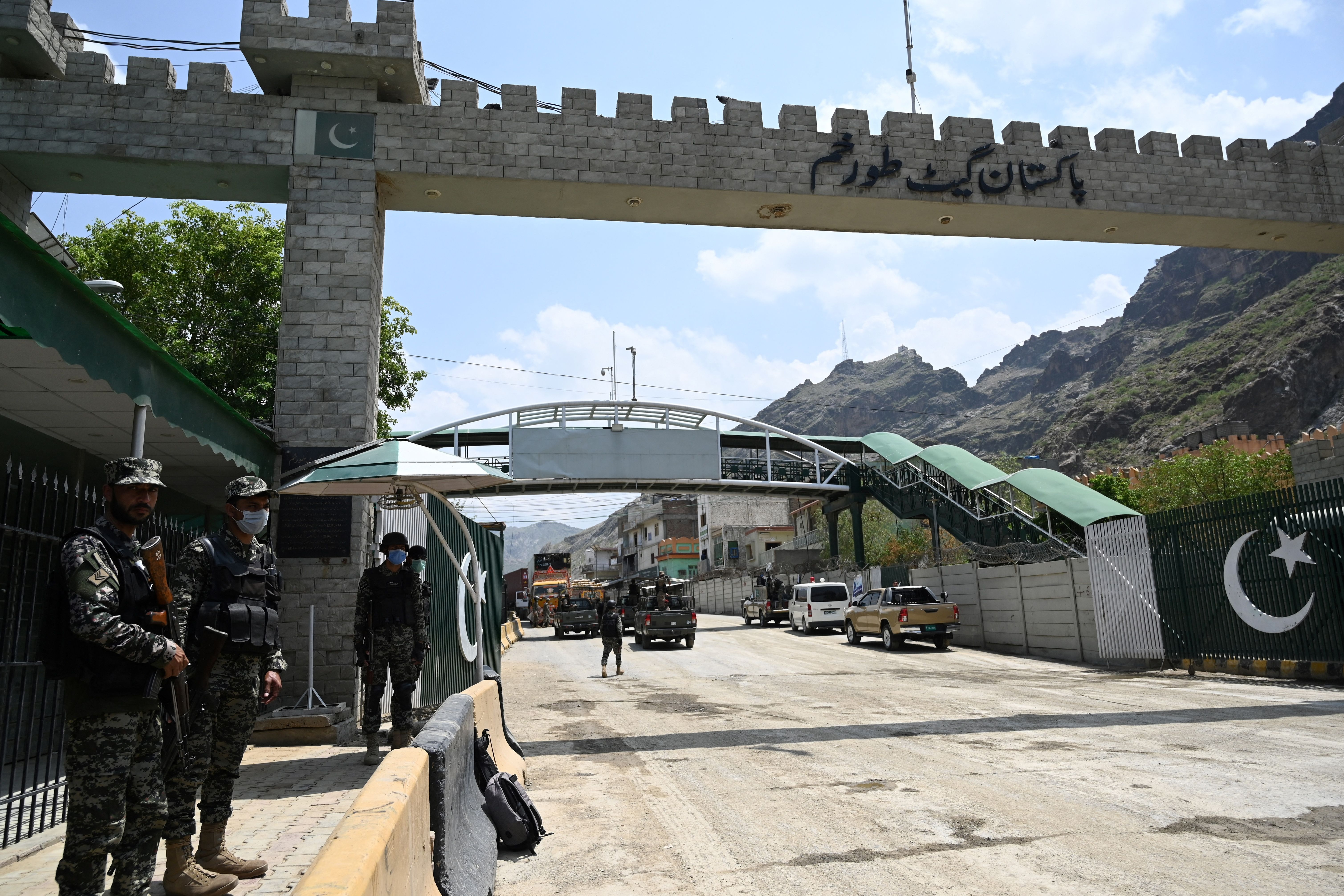 Pakistani paramilitary soldiers stand at the Torkham border crossing on August 3, 2021.