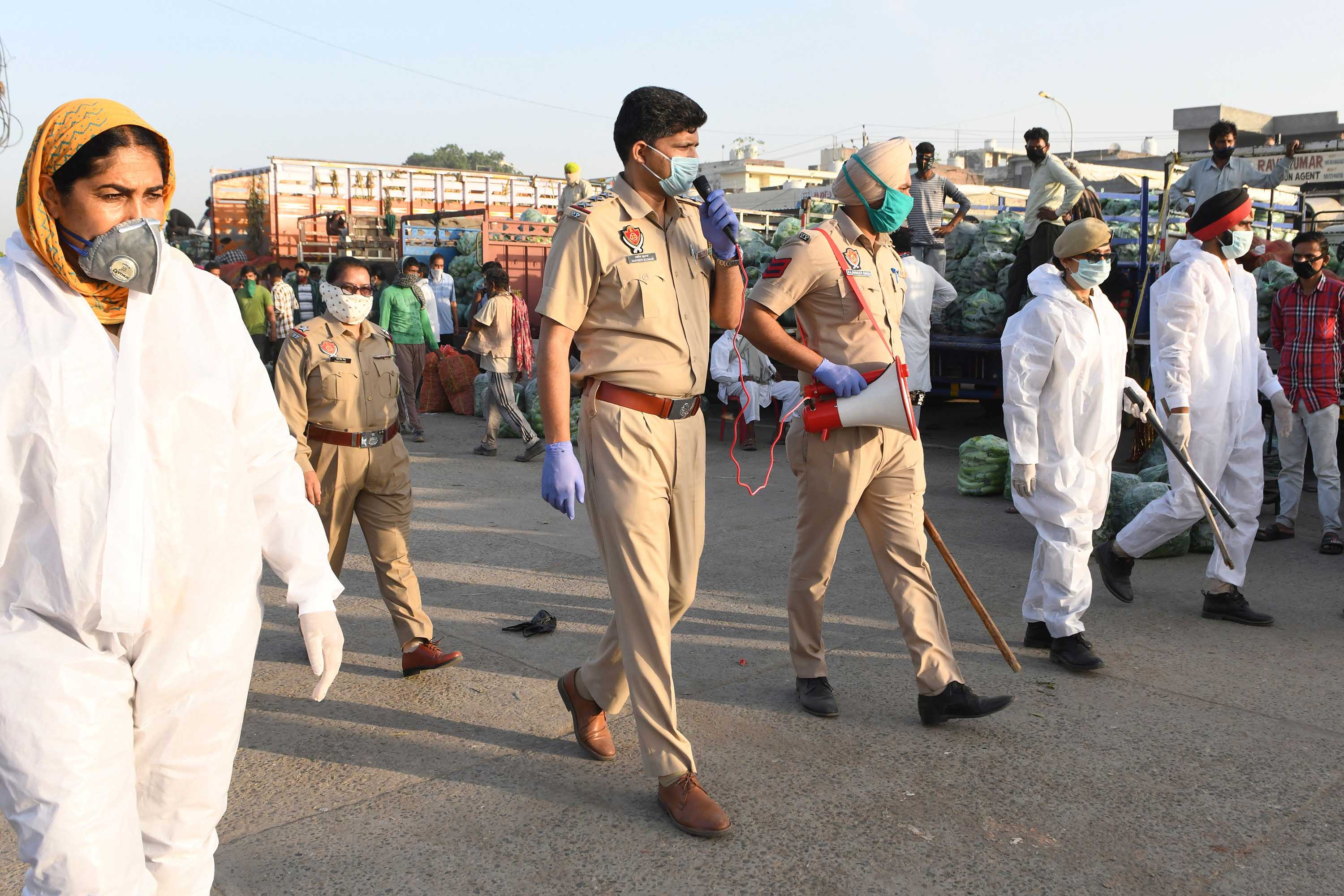 Punjab police personnel patrol a vegetable market during a government-imposed nationwide lockdown on the outskirts of Amritsar, India, on May 1.