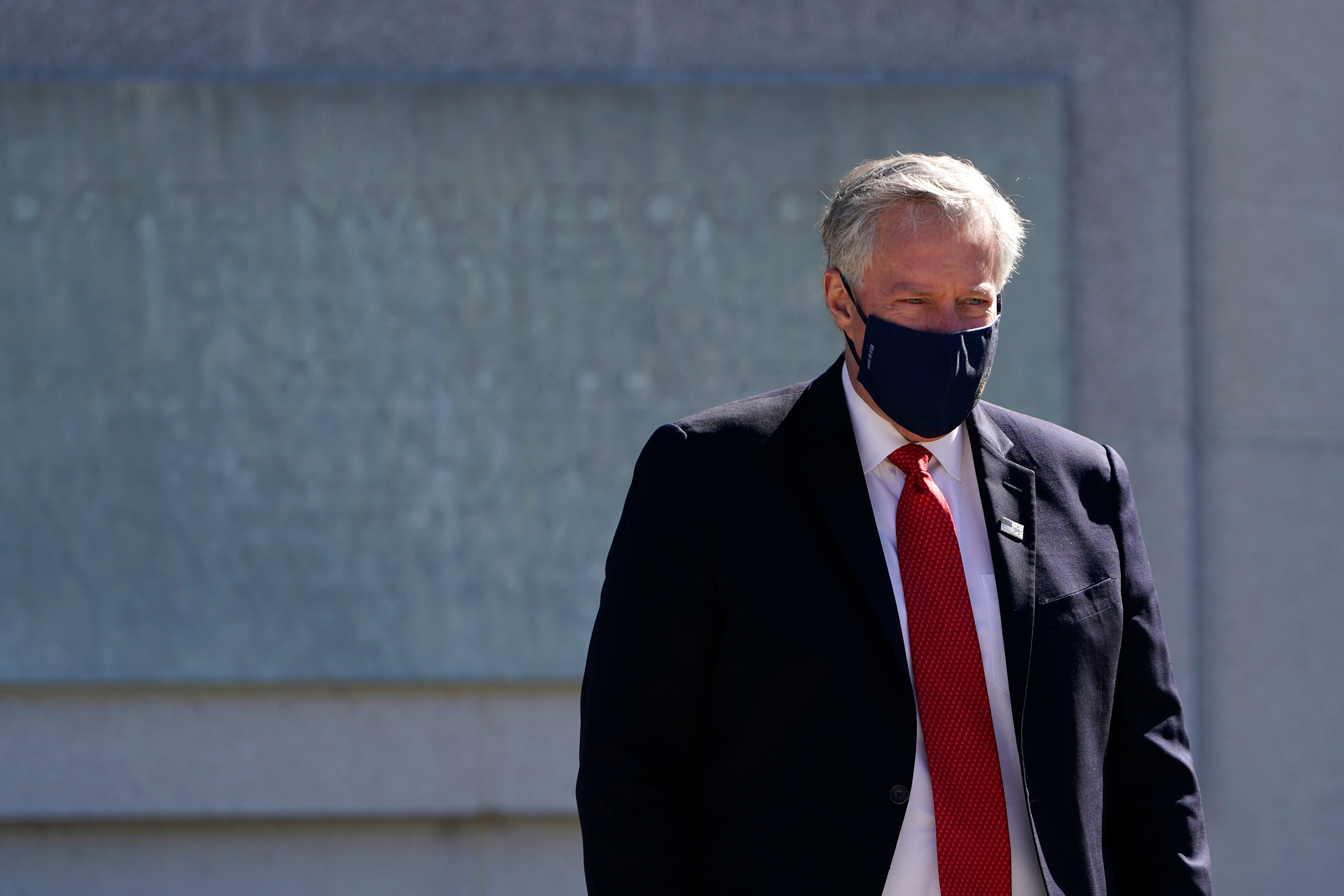 White House Chief of Staff Mark Meadows walks outside Walter Reed medical center in Bethesda, Maryland, on October 3.