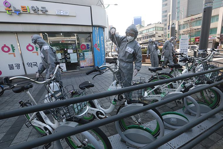 South Korean army soldiers spray disinfectant as a precaution against the new coronavirus on a street in Seoul, South Korea, Friday, March 6.