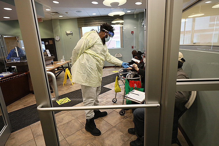 Seniors over 65 wait in the waiting room of the Central Boston Elder Services Inc. in Boston's Roxbury on February 19. The Covid-19 vaccine was given out there by the Harvard Street Neighborhood Health Center.