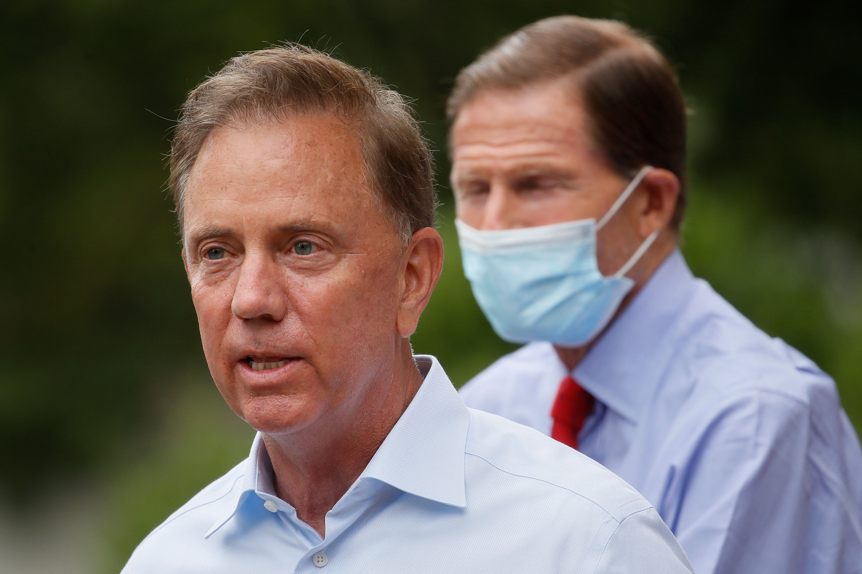 Gov. Ned Lamont speaks to reporters on August 7 in Westport, Connecticut.