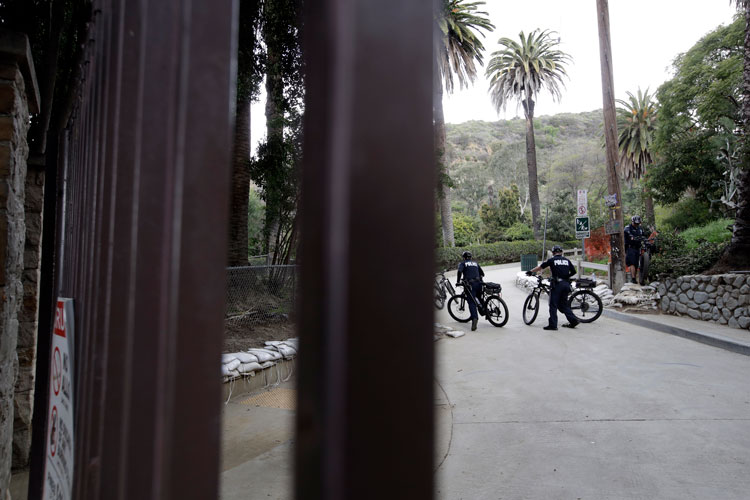 Police patrol Runyon Canyon park after it was closed to the public Wednesday, March 25, in Los Angeles.
