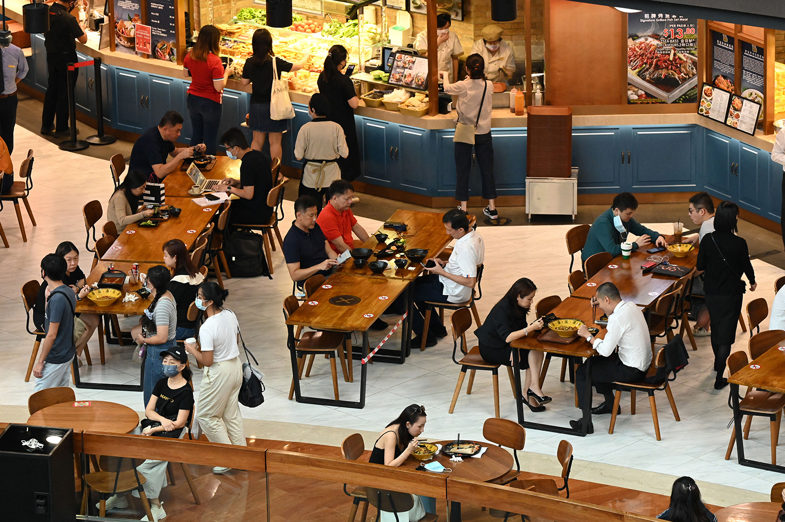 People dine at a restaurant in a shopping mall in Singapore, on May 14.