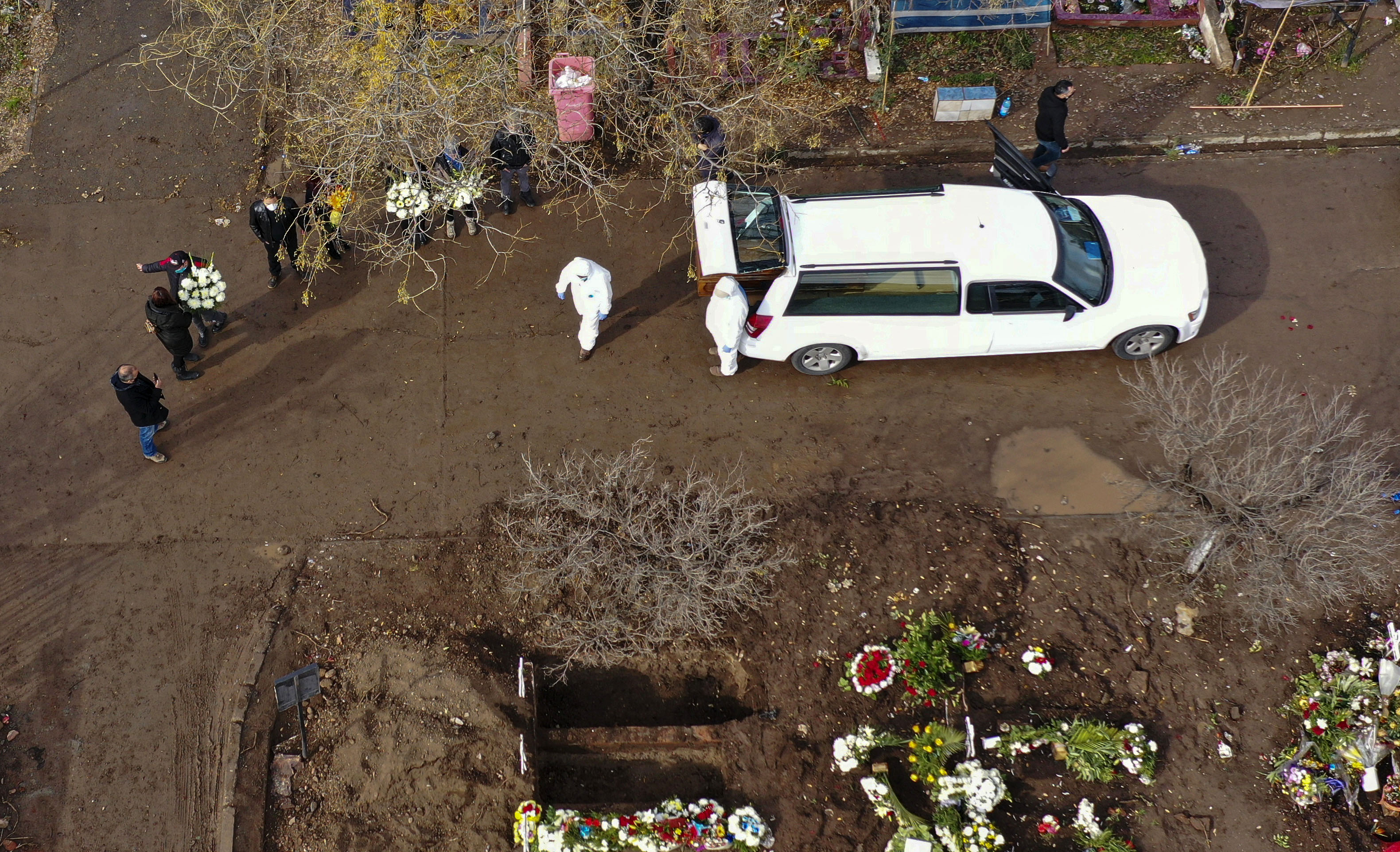 A person said to have died from Covid-19 is brought for burial to the General Cemetery in Santiago, Chile, on June 23.