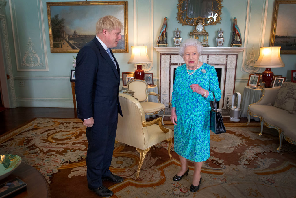 Johnson and the Queen on the day he became Prime Minister.