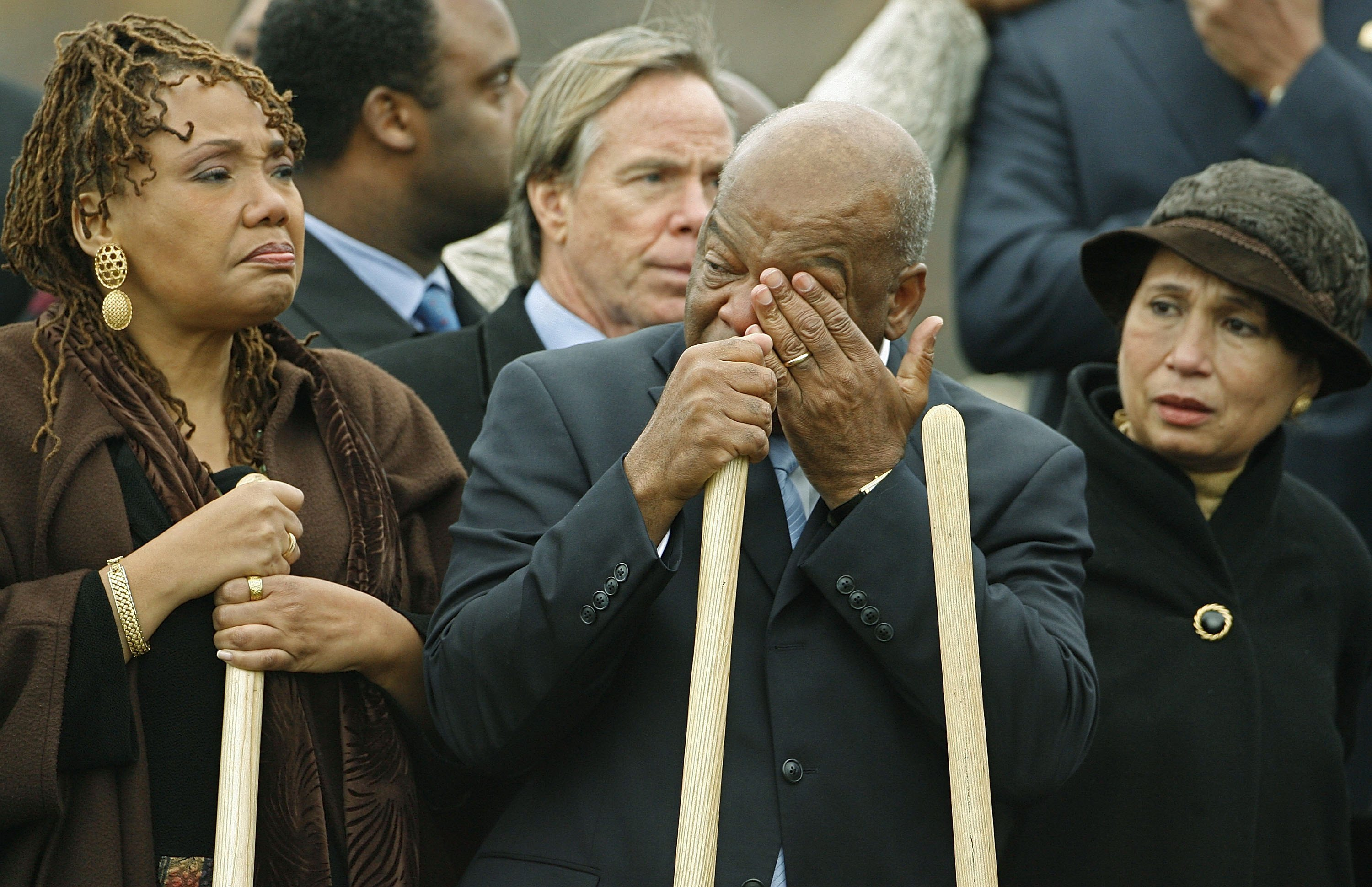 Bernice King (L), daughter of Martin Luther King Jr., stands next to Rep. John Lewis as he wipes away tears before breaking ground for the Martin Luther King Jr. National Memorial on November 13, 2006 in Washington, DC.