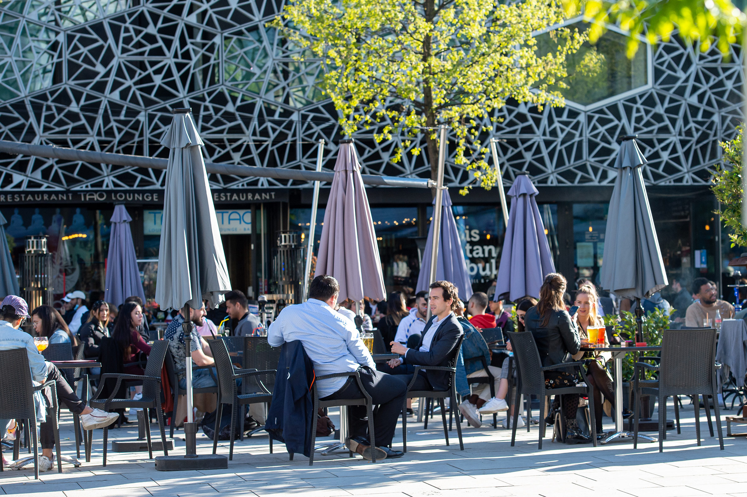 People sit outside at a restaurant in Lausanne, Switzerland, on May 3.