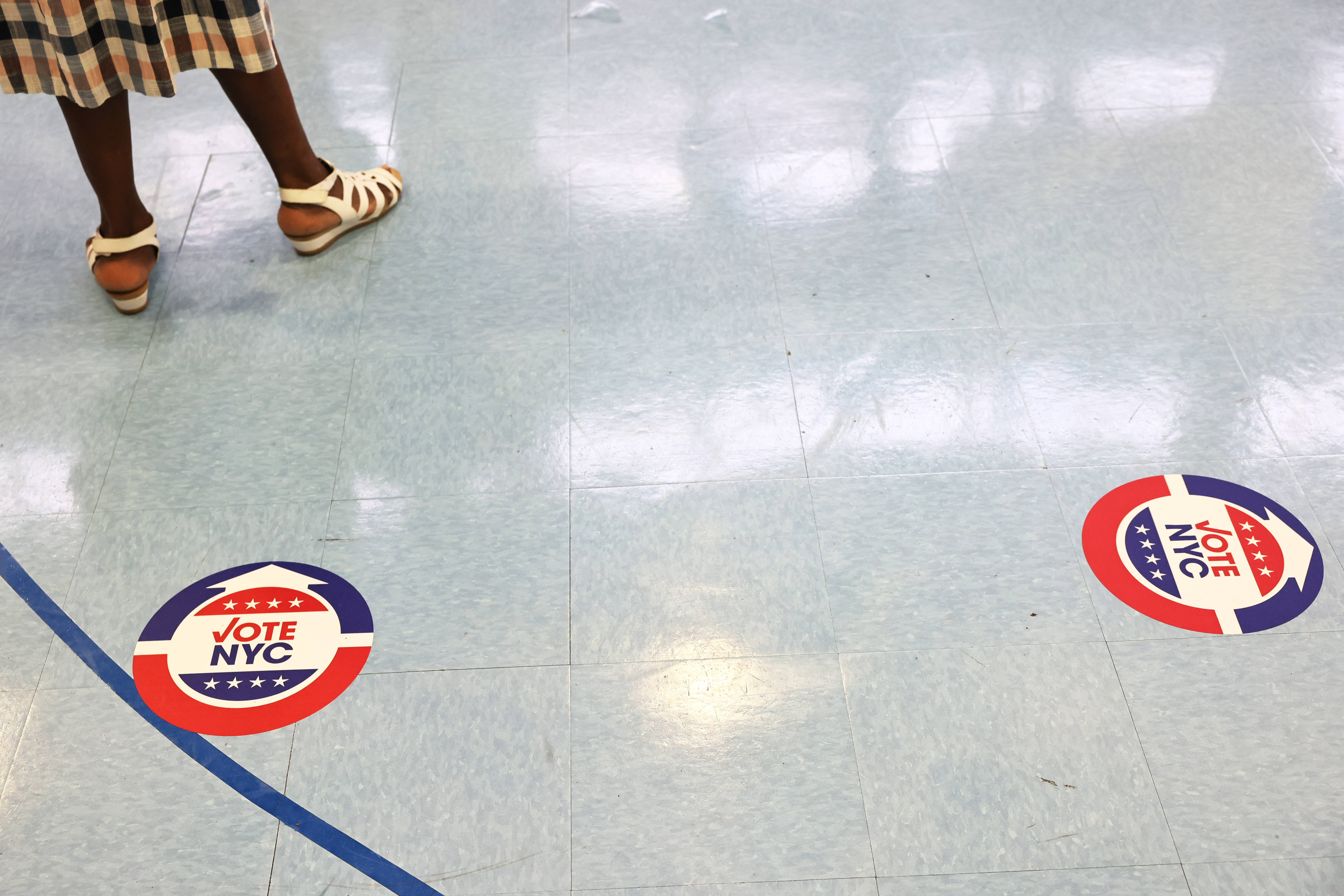 A person waits in line to vote during the Primary Election Day at P.S. 81 on June 22, 2021 in the Bedford-Stuyvesant neighborhood of Brooklyn borough in New York City.